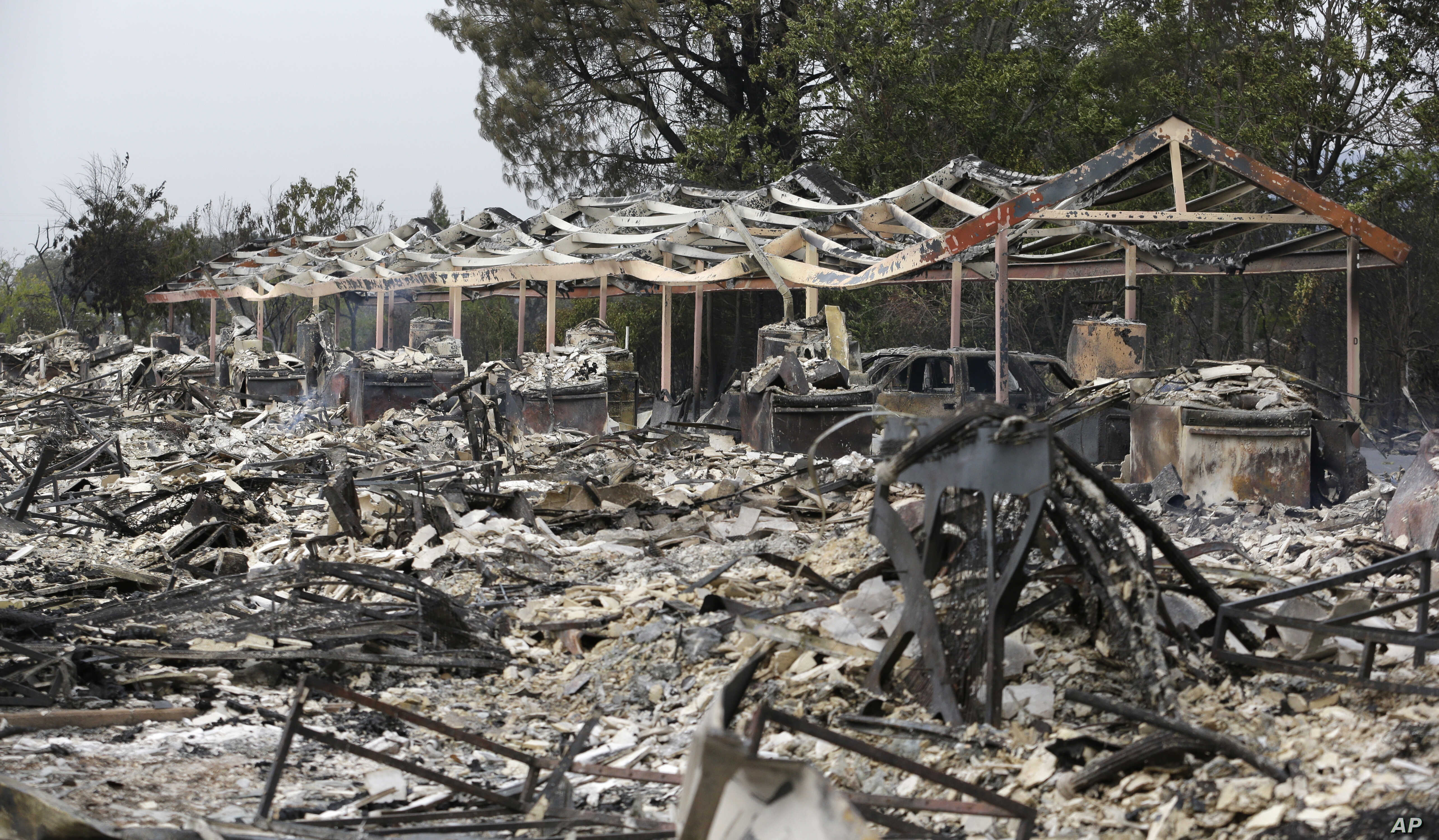 The charred remains of an apartment complex remain that burned from a wildfire two days earlier, Sept. 14, 2015, in Middletown, Calif.
