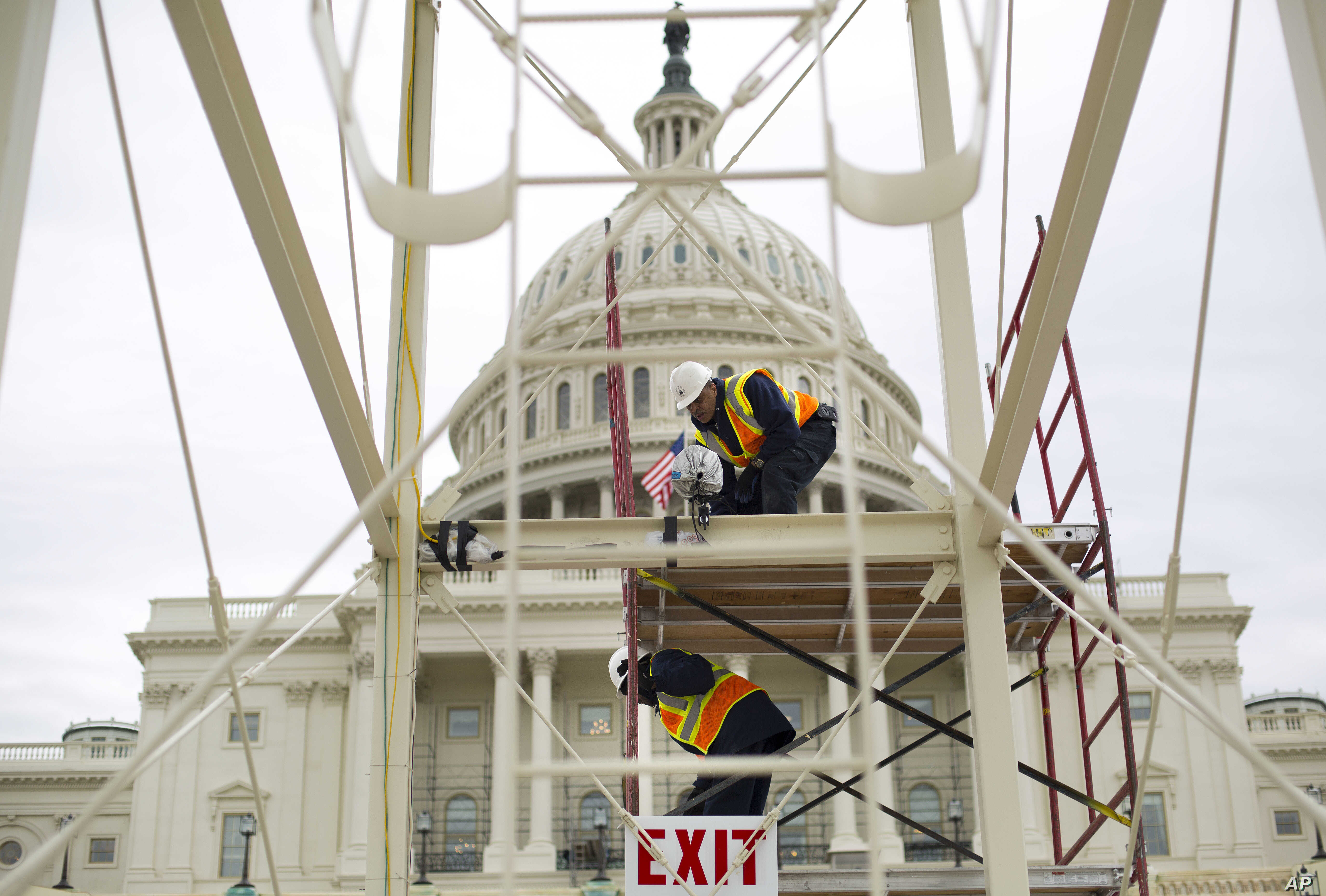 Construction continues on the inaugural platform in preparation for the swearing-in ceremonies for President-elect Donald Trump on the Capitol steps in Washington, Dec. 8, 2016.