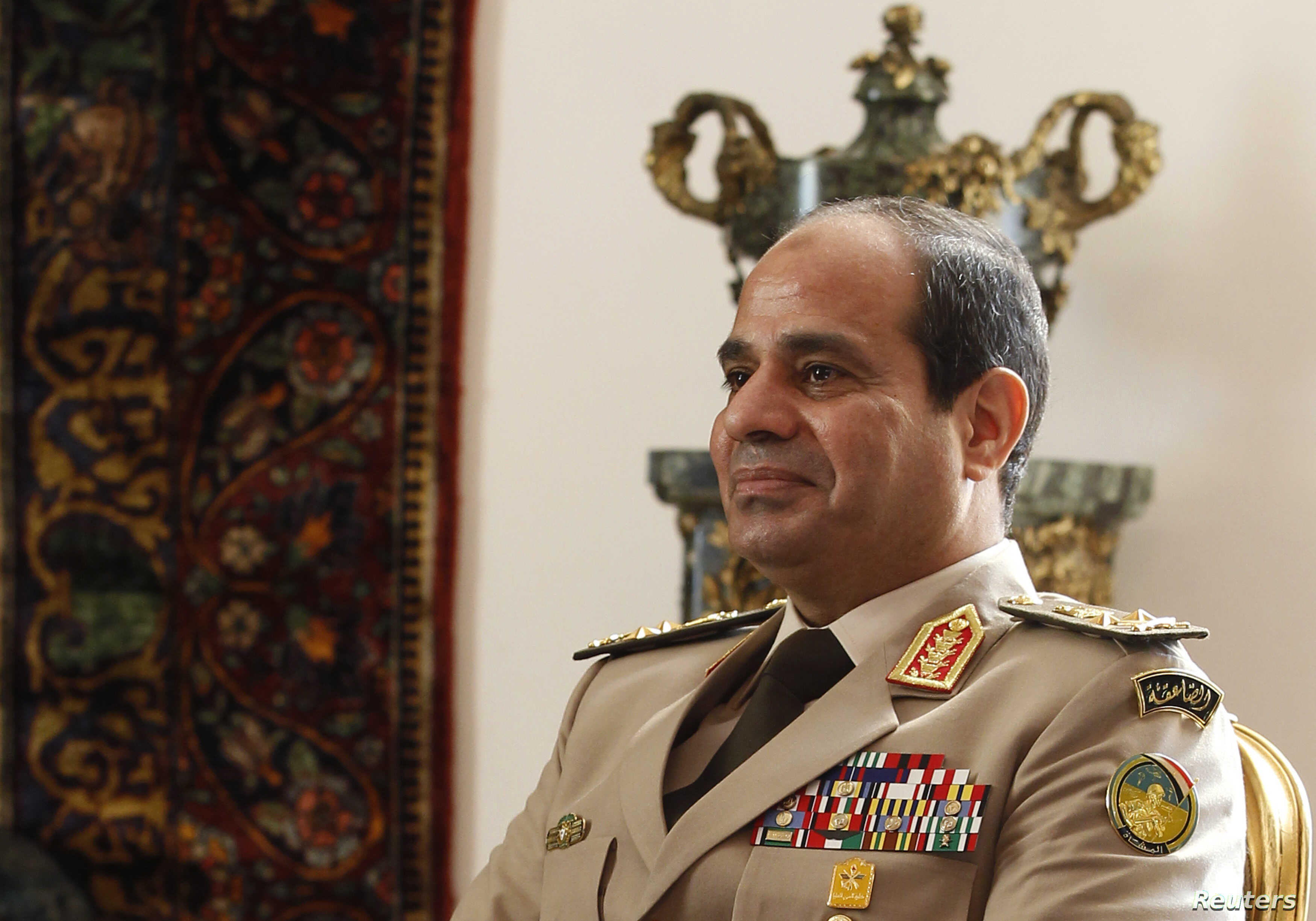 Egypt's Army Chief General Abdel Fattah el-Sissi attends a meeting with Egypt's interim President Adly Mansour, Russia's Defense Minister Sergei Shoigu and Foreign Minister Sergei Lavrov (not pictured) at El-Thadiya presidential palace in Cairo, Nov....
