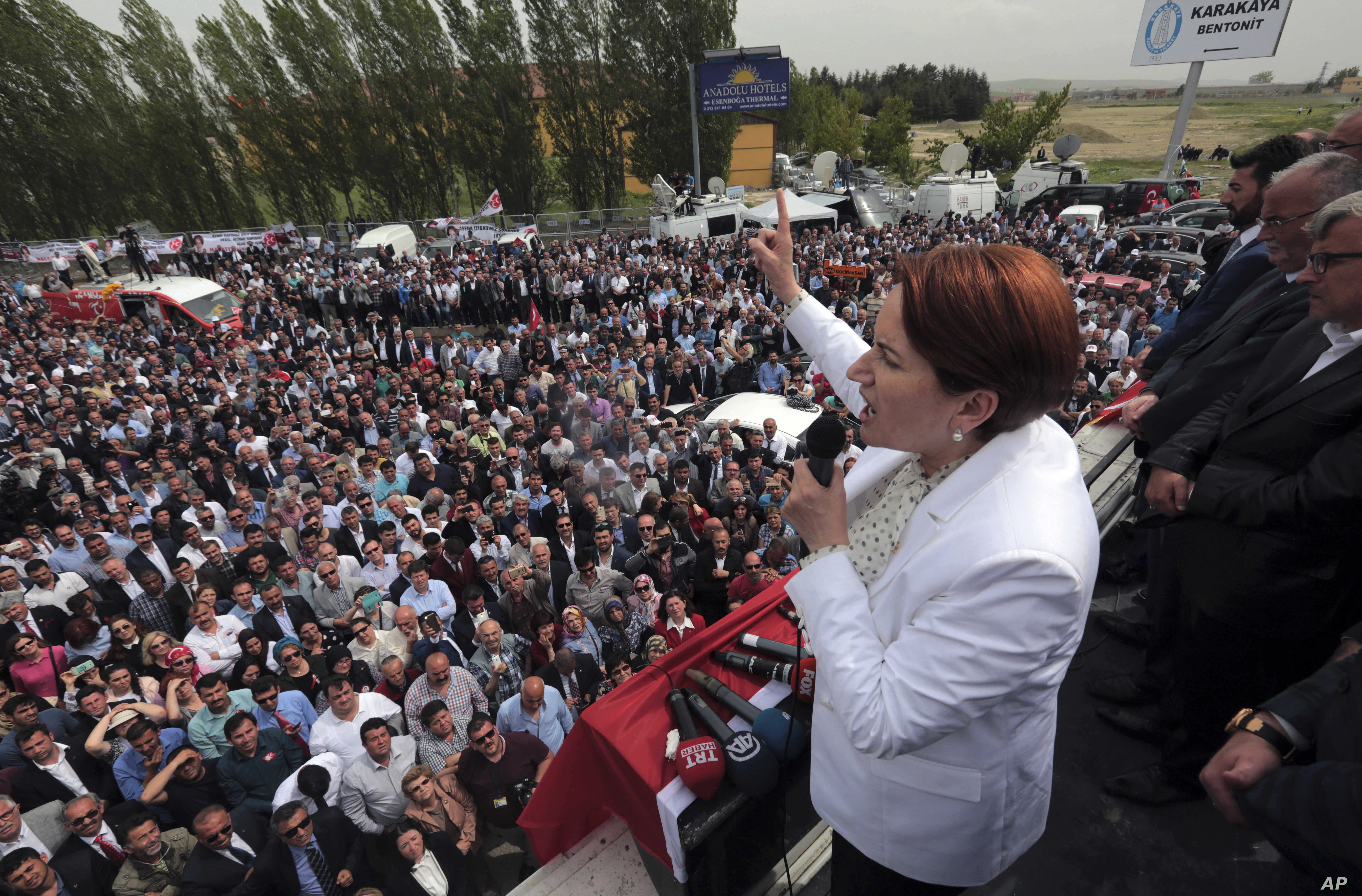FILE - Meral Aksener addresses supporters of Turkey's opposition Nationalist Movement Party, MHP, as riot police sealed off a hotel to prevent thousands of dissidents in the party from holding a congress to oust Devlet Bahceli, leader for the last tw...