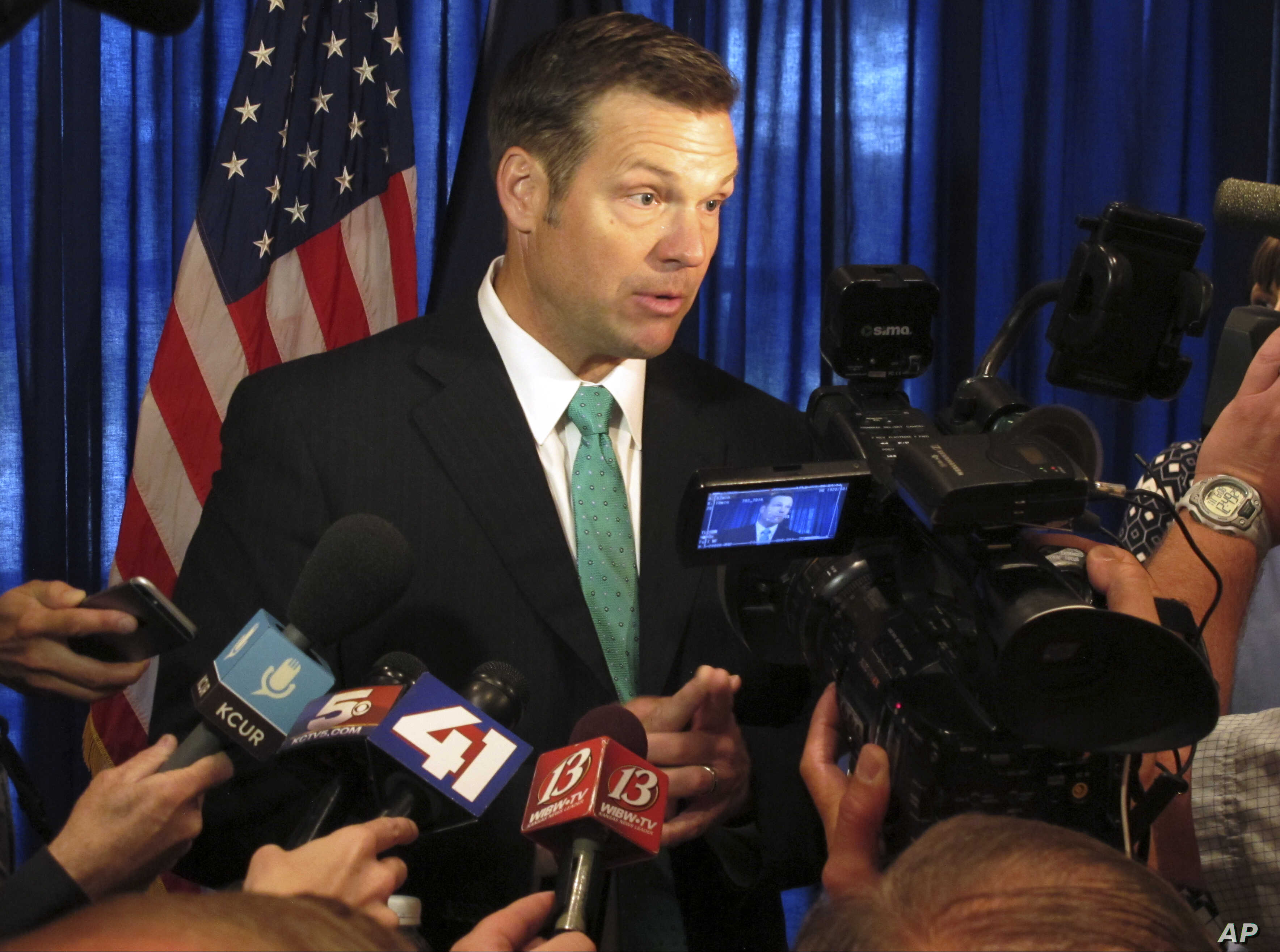Kansas Secretary of State Kris Kobach speaks to supporters in launching his campaign for the Republican nomination for governor, June 8, 2017, at an events center in Lenexa, Kansas.