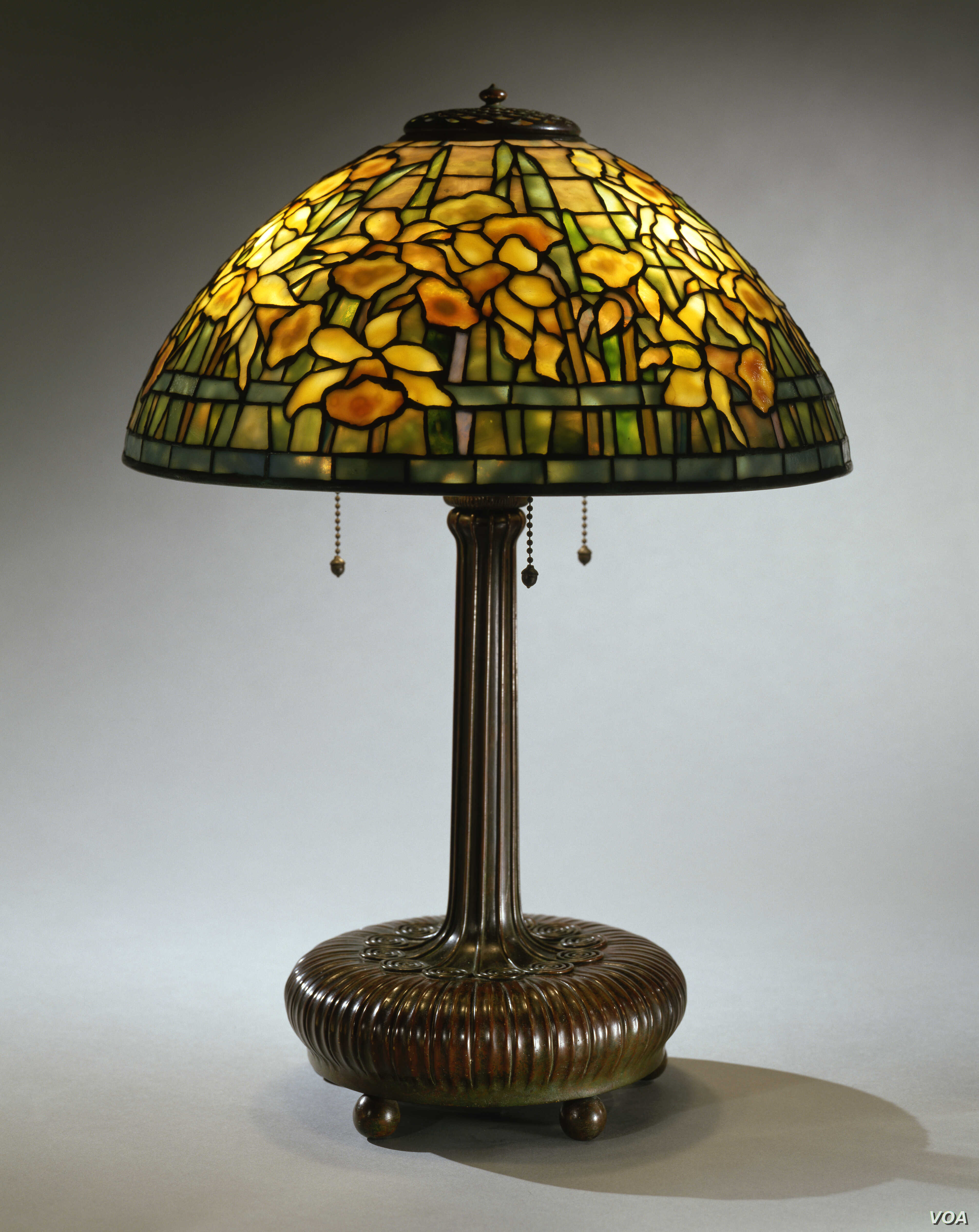 """The """"Daffodil"""" lampshade the Neustadts purchased from a second-hand shop in Greenwich Village, New York, for $12.50 is now worth between $50,000 and $75,000. (Courtesy of The Neustadt Collection of Tiffany Glass)"""