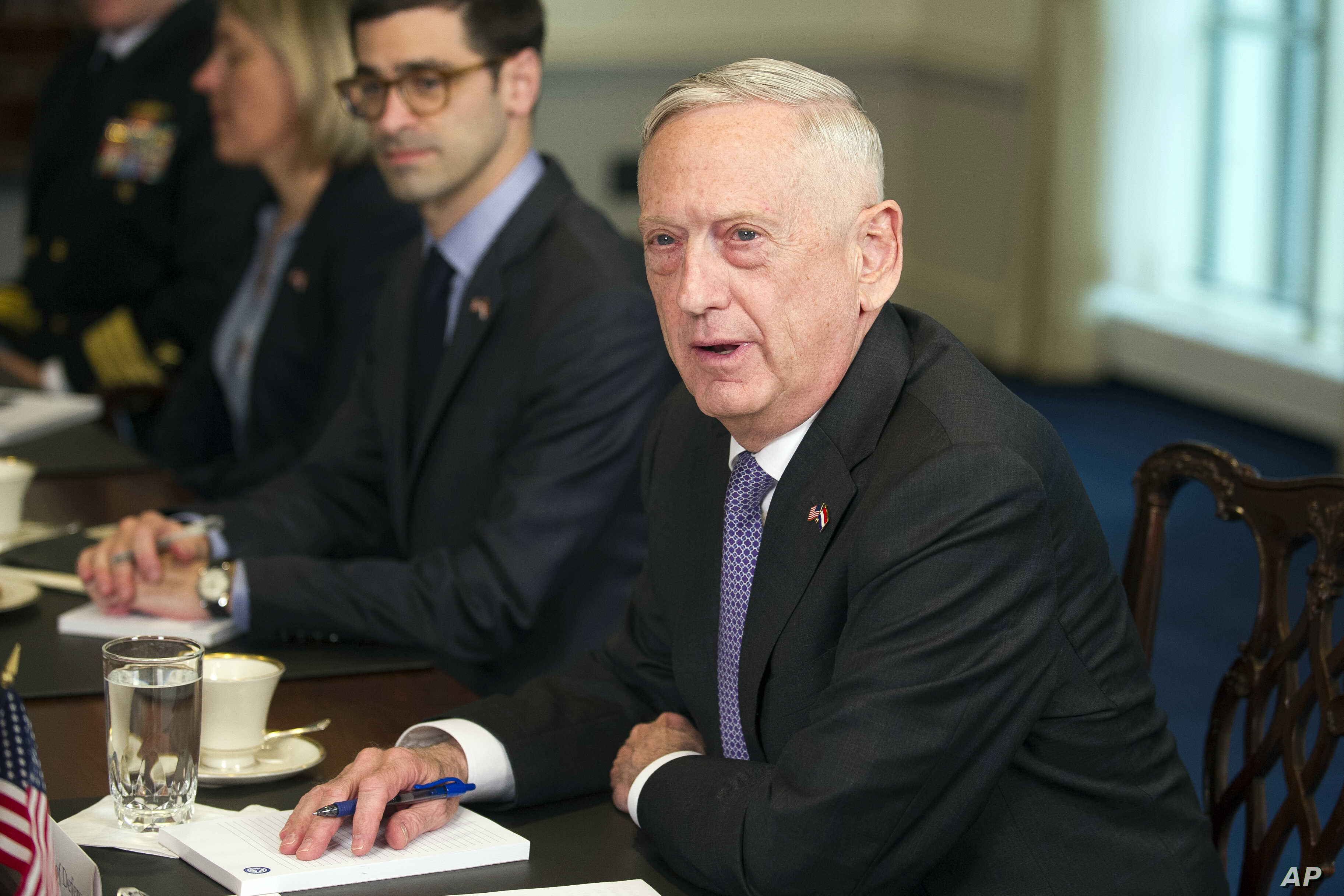 Defense Secretary Jim Mattis responds to reporter's question about military action in Syria during a meeting with Netherlands Minister of Defense Ank Bijleveld at the Pentagon in Washington, April 11, 2018.