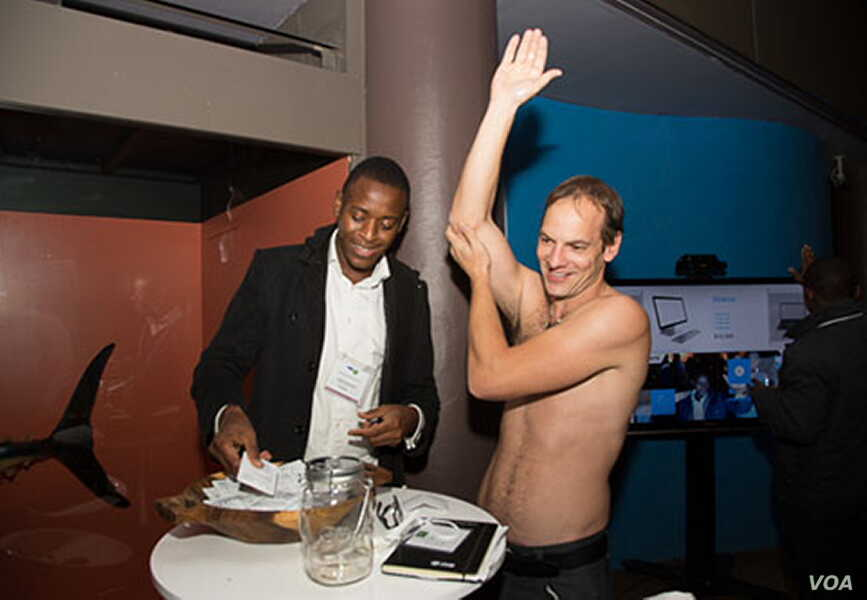 Ludwick Marishane (left) watches as a man demonstrates how to use his unique invention. (Courtesy - Ludwick Marishane)
