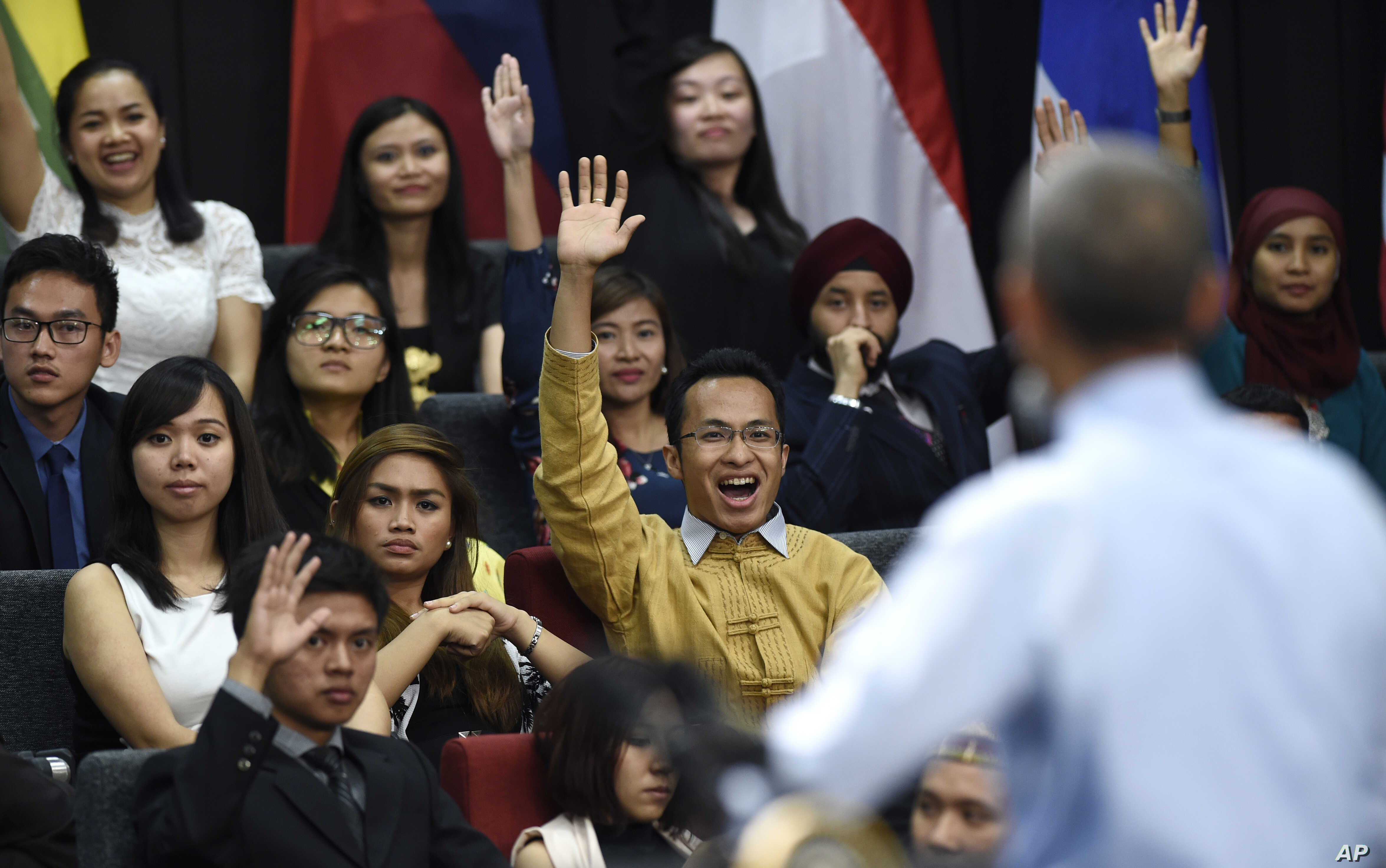 Audience members raise their hands in hopes of asking U.S. President Barack Obama a question as he speaks at the Young Southeast Asian Leaders Initiative (YSEALI) town hall at Taylor's University in Kuala Lumpur, Malaysia, Nov. 20, 2015.