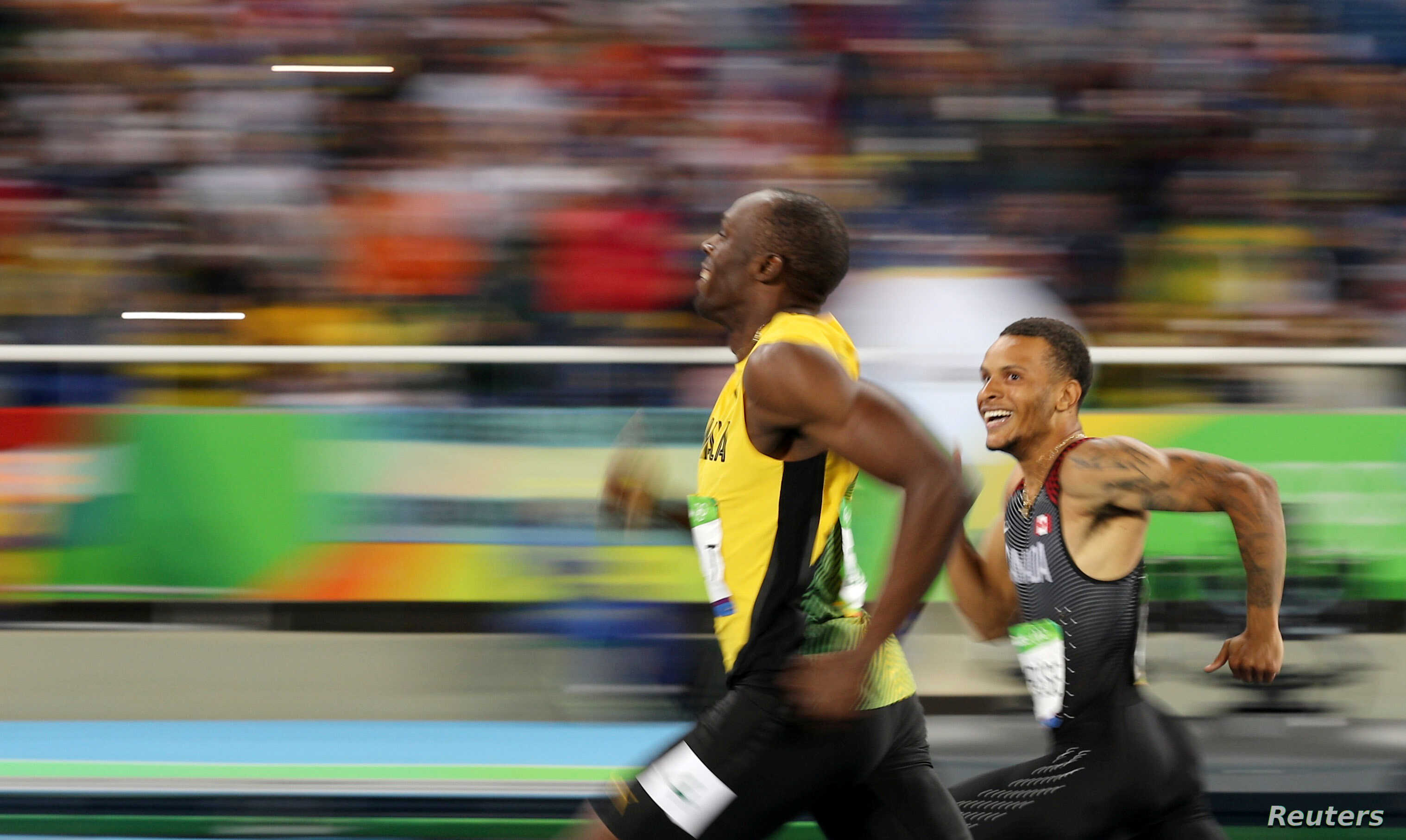 FILE -  Jamaica's Usain Bolt and Canada's Andre De Grasse smile as they compete in the Men's 200m Semifinals at the Rio Olympics,  Aug. 17, 2016.