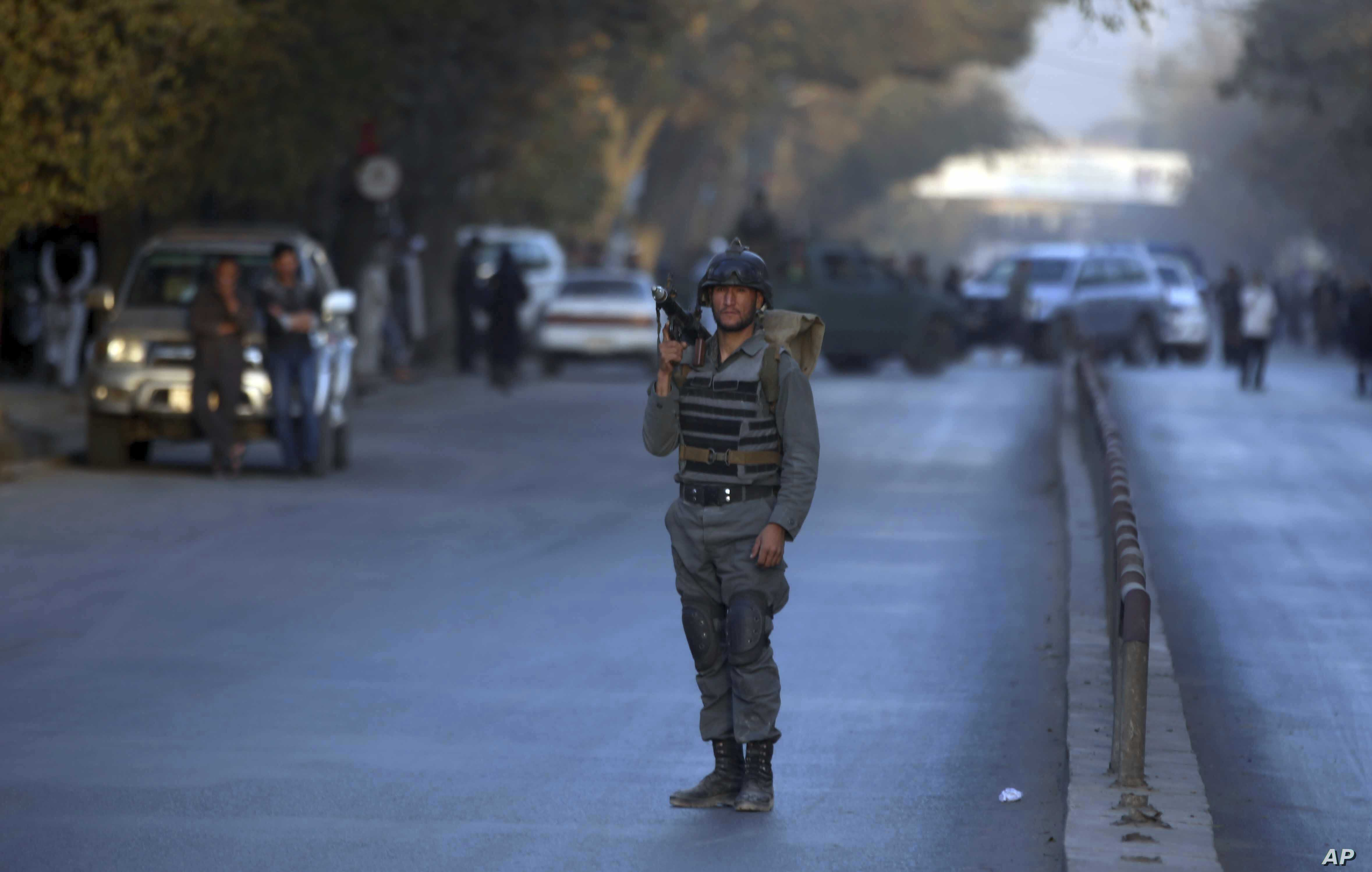 A policeman stands guard at the site of a suicide attack in central Kabul, Afghanistan, Oct. 31, 2017.