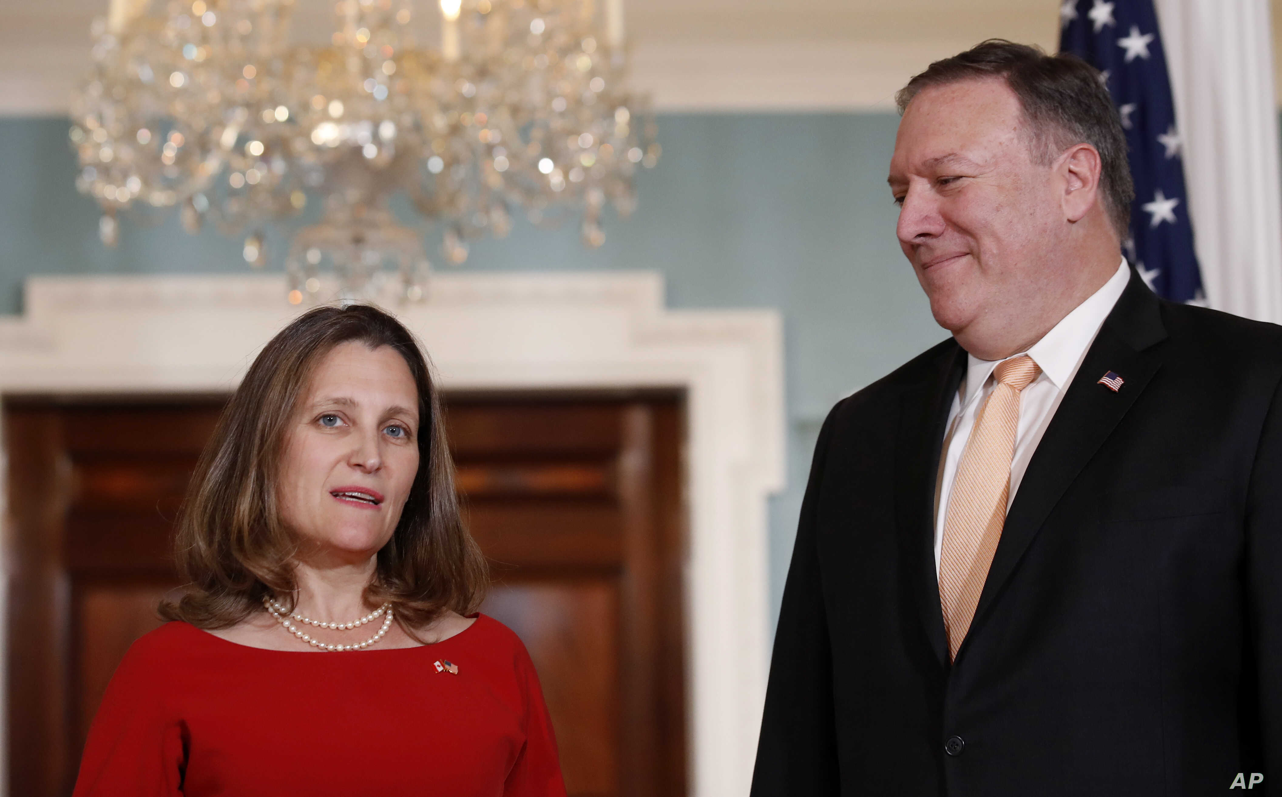 Canadian Minister of Foreign Affairs, Chrystia Freeland speaks with Secretary of State Mike Pompeo, before their meeting at the State Department, May 11, 2018 in Washington.