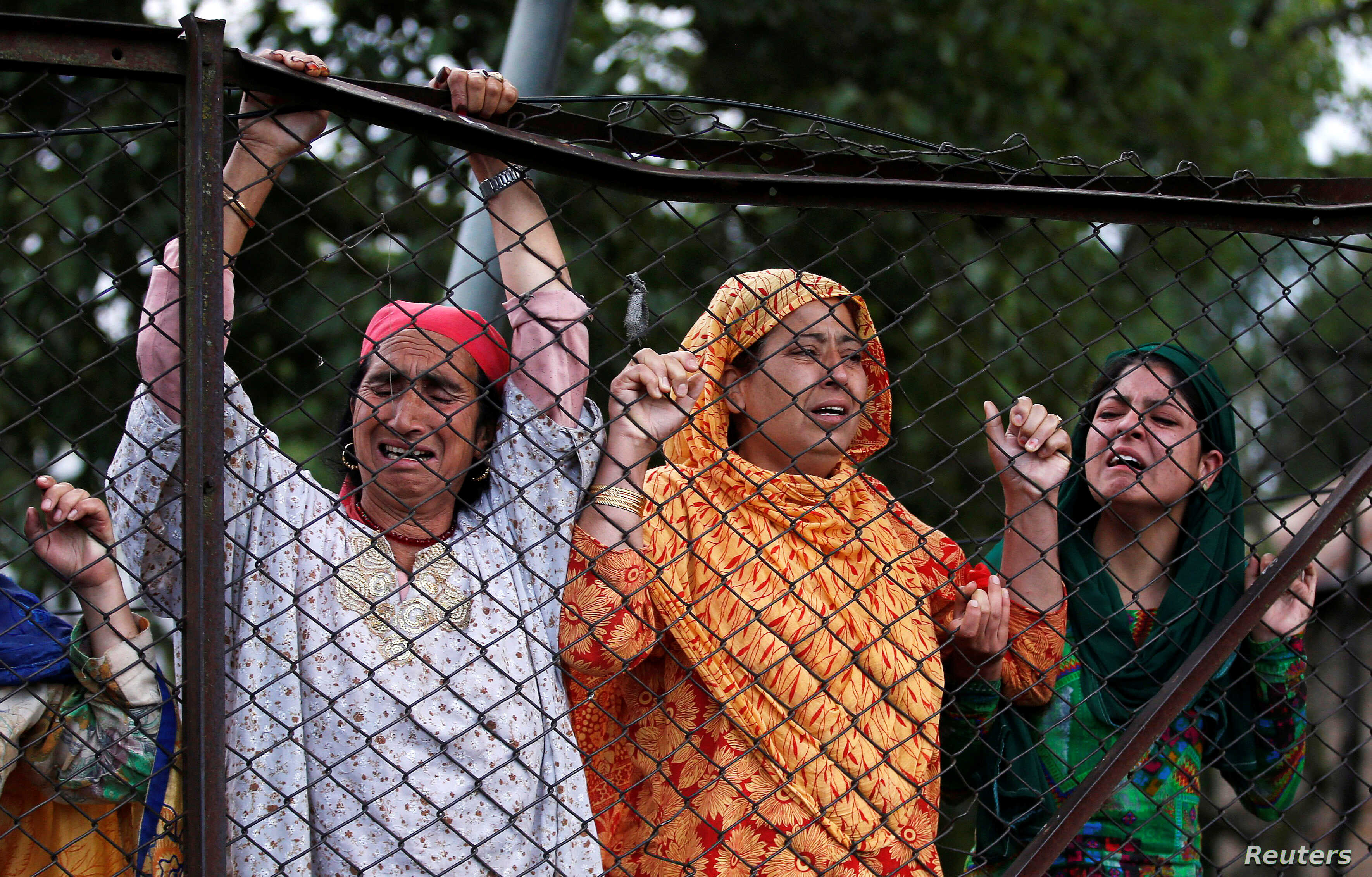 Kashmiri women mourn the death of Burhan Wani, a separatist militant leader, during his funeral in Tral, south of Srinagar, July 9, 2016.
