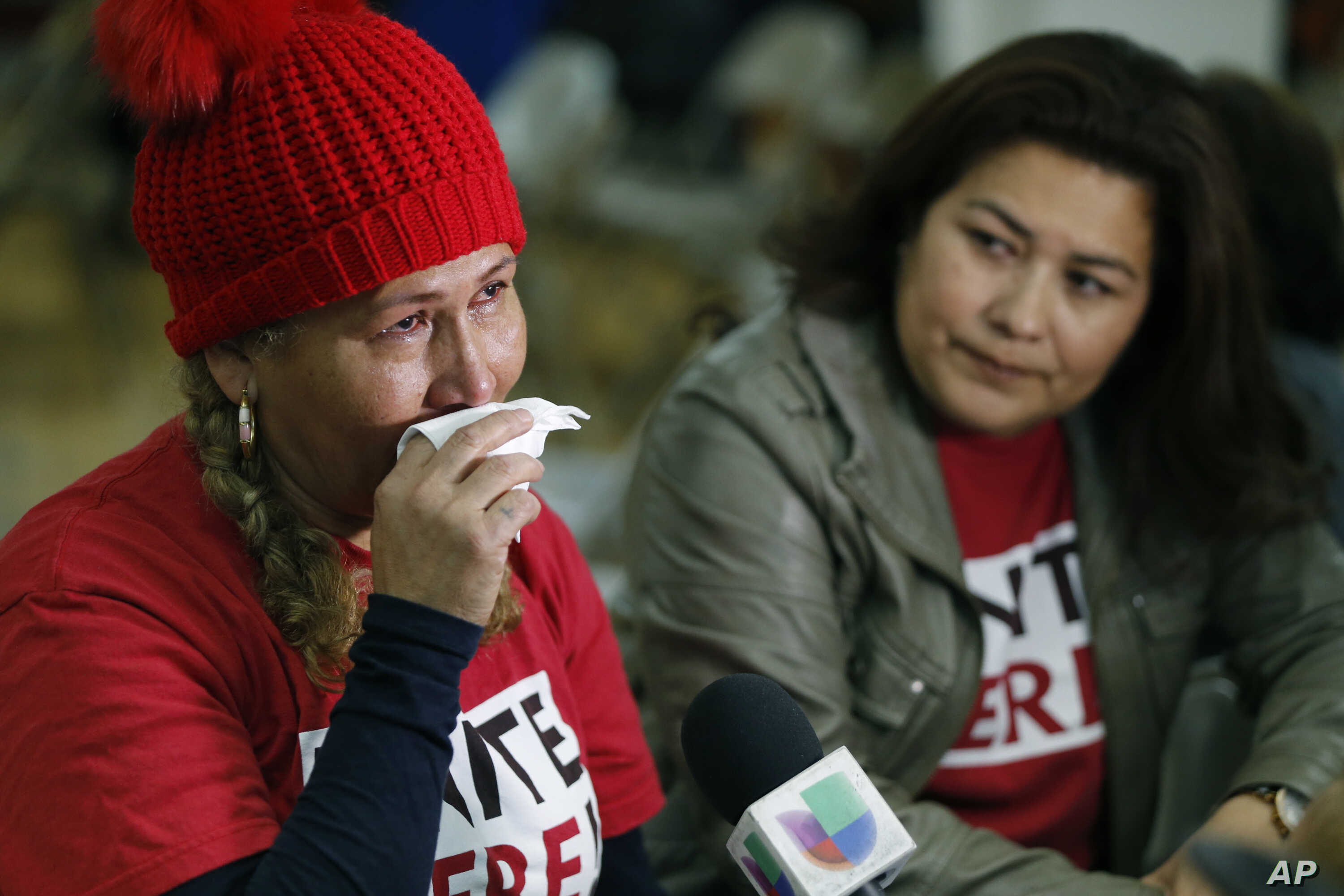 El Salvador immigrants Diana Paredes, left, and Isabel Barrera react at a news conference following an announcement on Temporary Protected Status for nationals of El Salvador, in Los Angeles, Jan. 8, 2018.