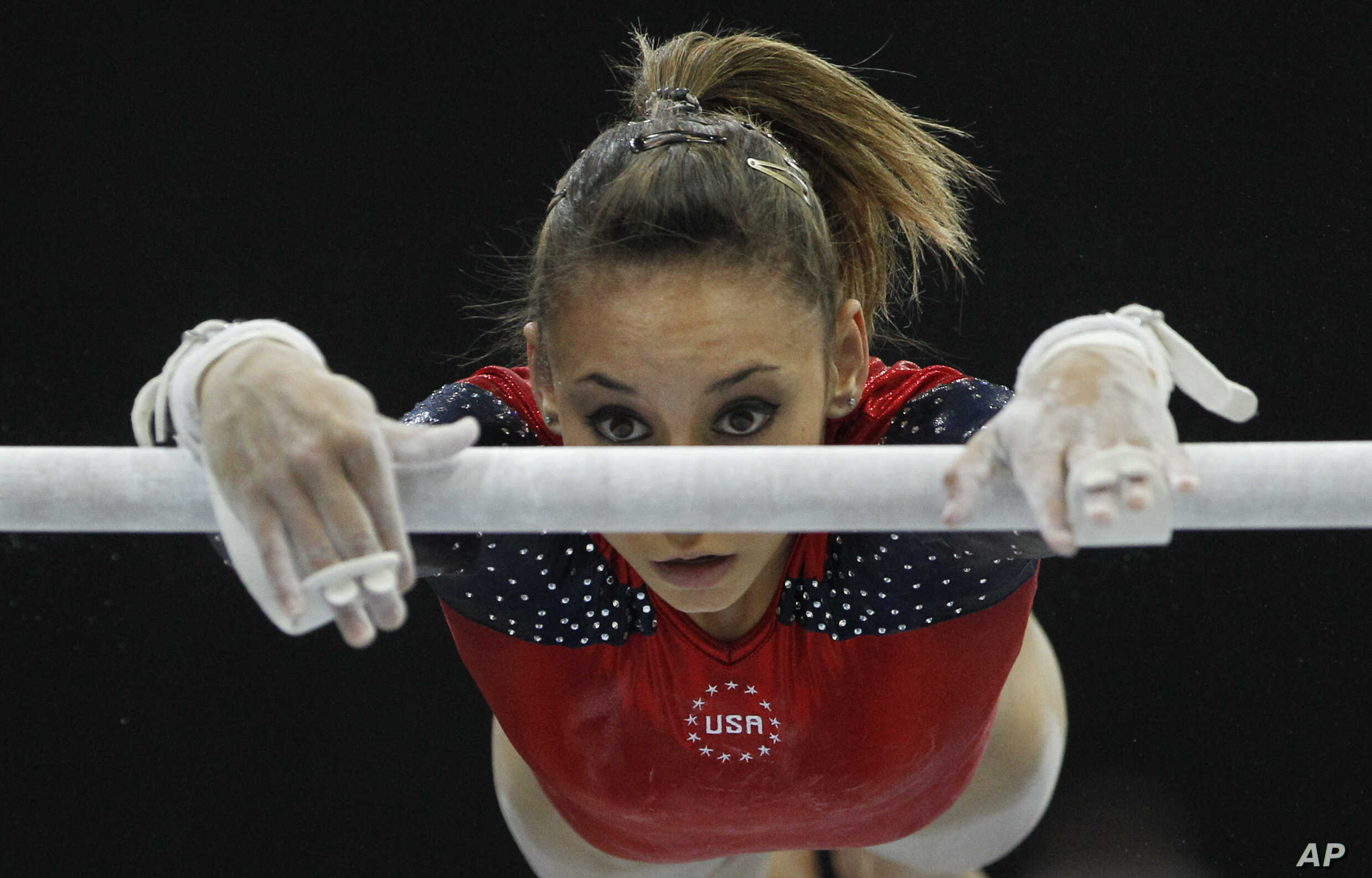 FILE - In this Oct. 17, 2010, photo, Mattie Larson of the U.S. performs on the uneven bars.  Larson, who was molested by Larry Nassar and was among the nearly 250 who gave victim impact statements during his sentencing, said the doctor cleared her on...