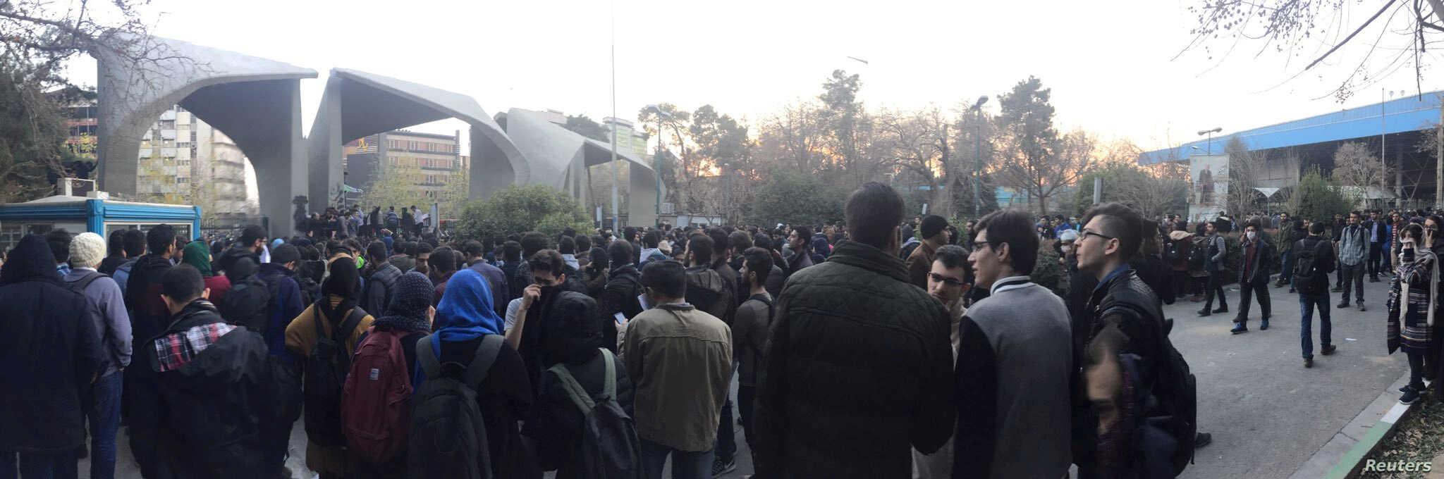 People protest near the university of Tehran, Iran, Dec. 30, 2017 in this picture obtained from social media.