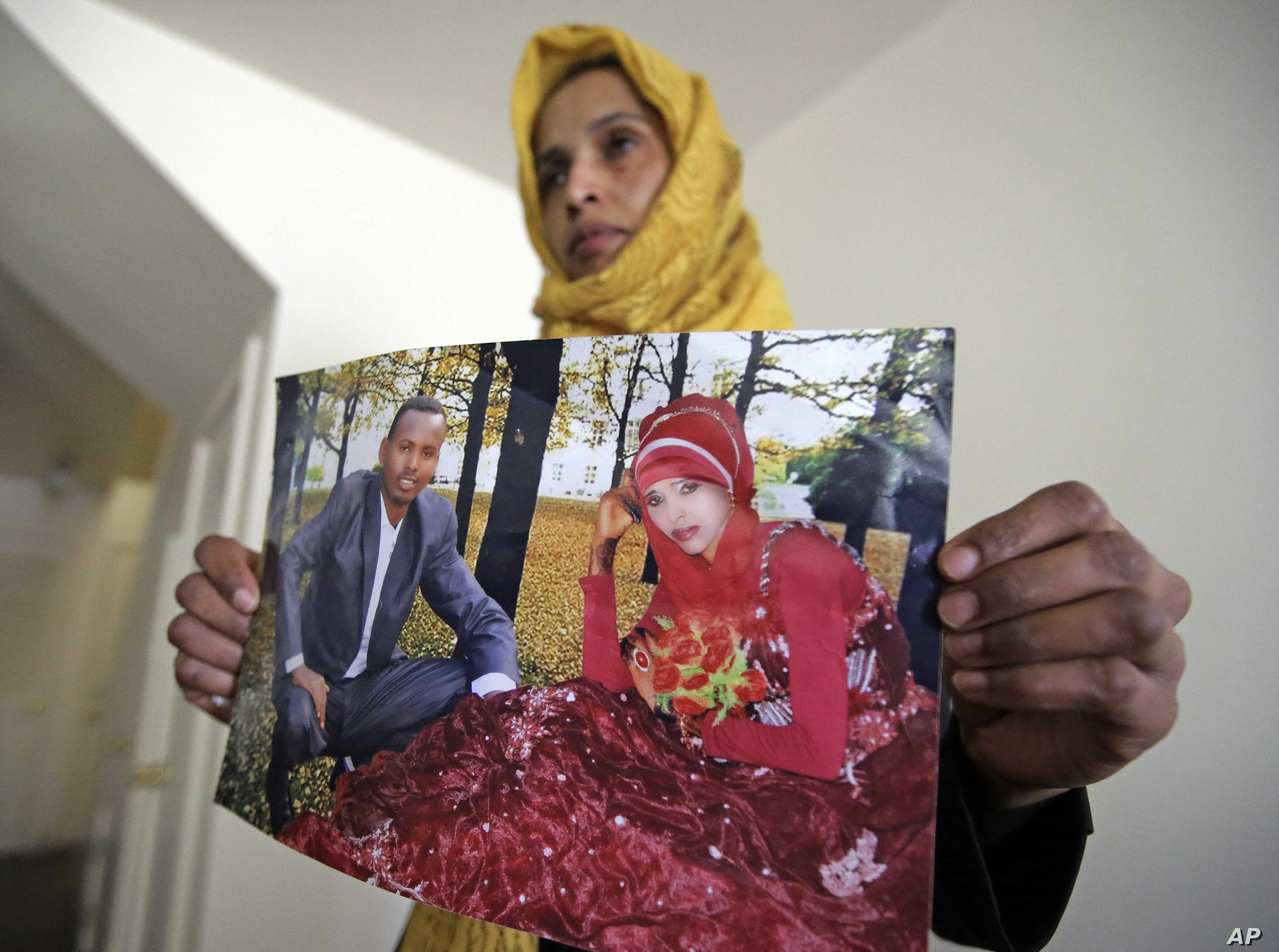 Somali refugee Nimo Hashi holds a photo of her husband Tuesday, Jan. 31, 2017,  in Salt Lake City. Hashi bought a new kitchen table and couches for her Salt Lake City apartment in joyful anticipation of reuniting Friday with her husband for the first...