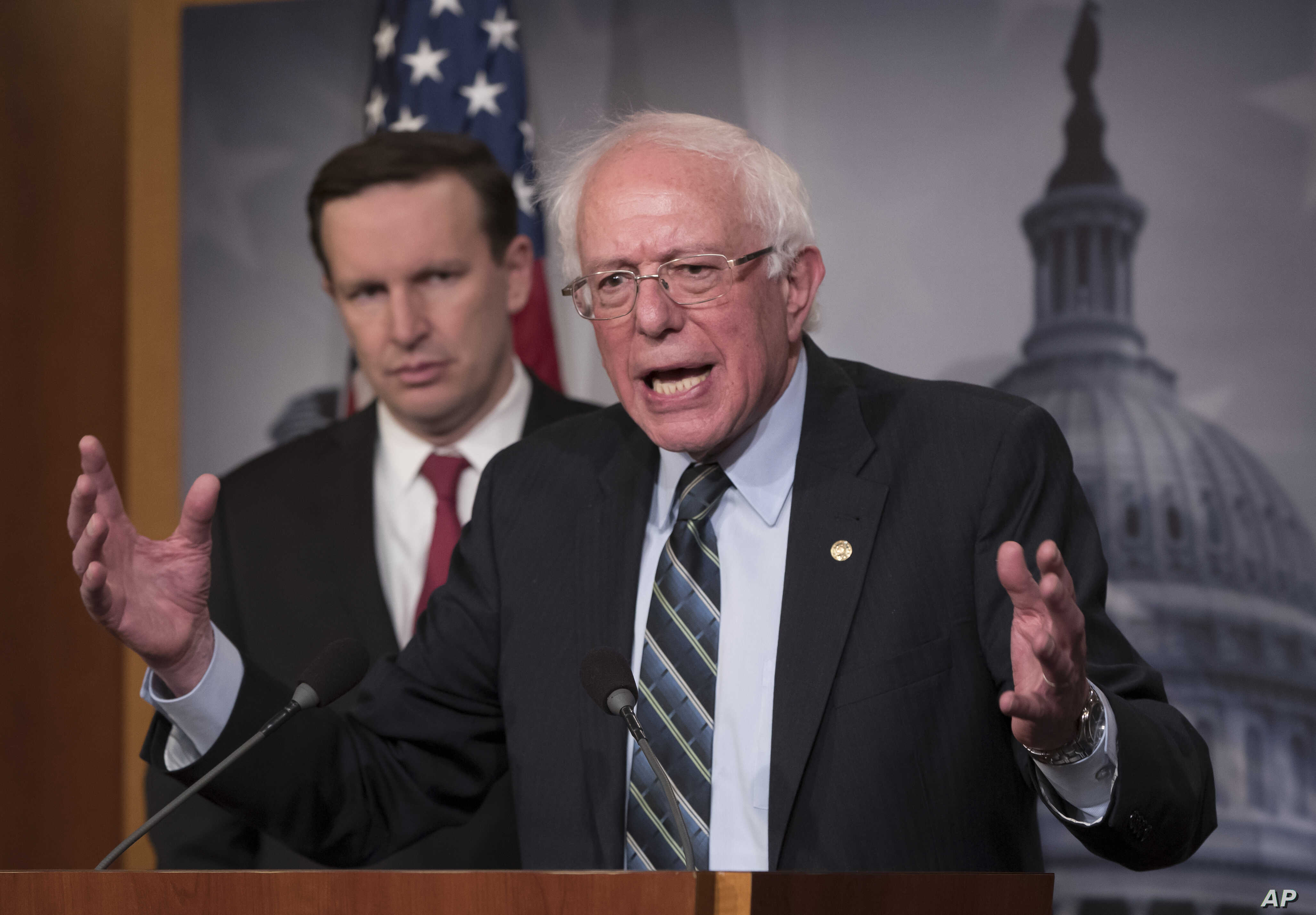 Sen. Bernie Sanders, I-Vt., joined at left by Sen. Chris Murphy, D-Conn., holds a news conference after the Senate passed a resolution he introduced that would pull assistance from the Saudi-led war in Yemen, a measure to rebuke Saudi Arabia after th...