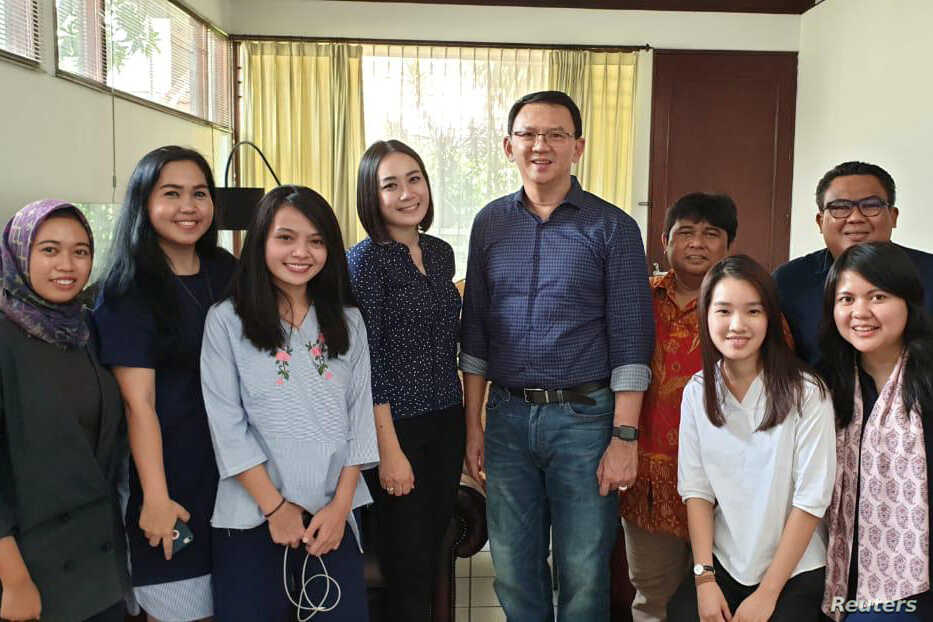 """Former Jakarta Governor Basuki """"Ahok"""" Tjahaja Purnama poses with his relatives after being released from prison in Jakarta, Indonesia, Jan. 24, 2019."""