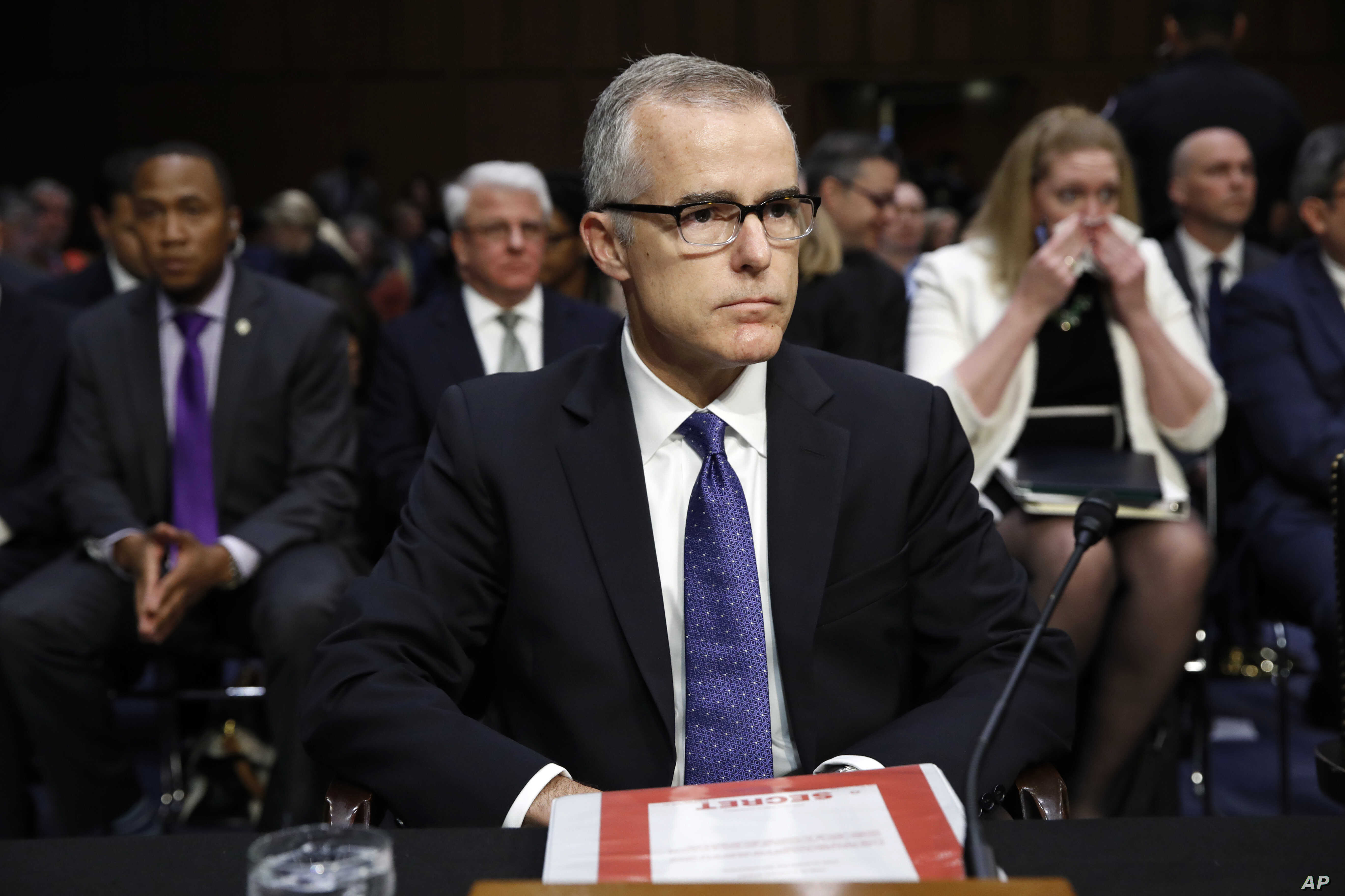 "Acting FBI Director Andrew McCabe sits with a folder marked ""Secret"" in front of him while testifying on Capitol Hill in Washington, May 11, 2017."
