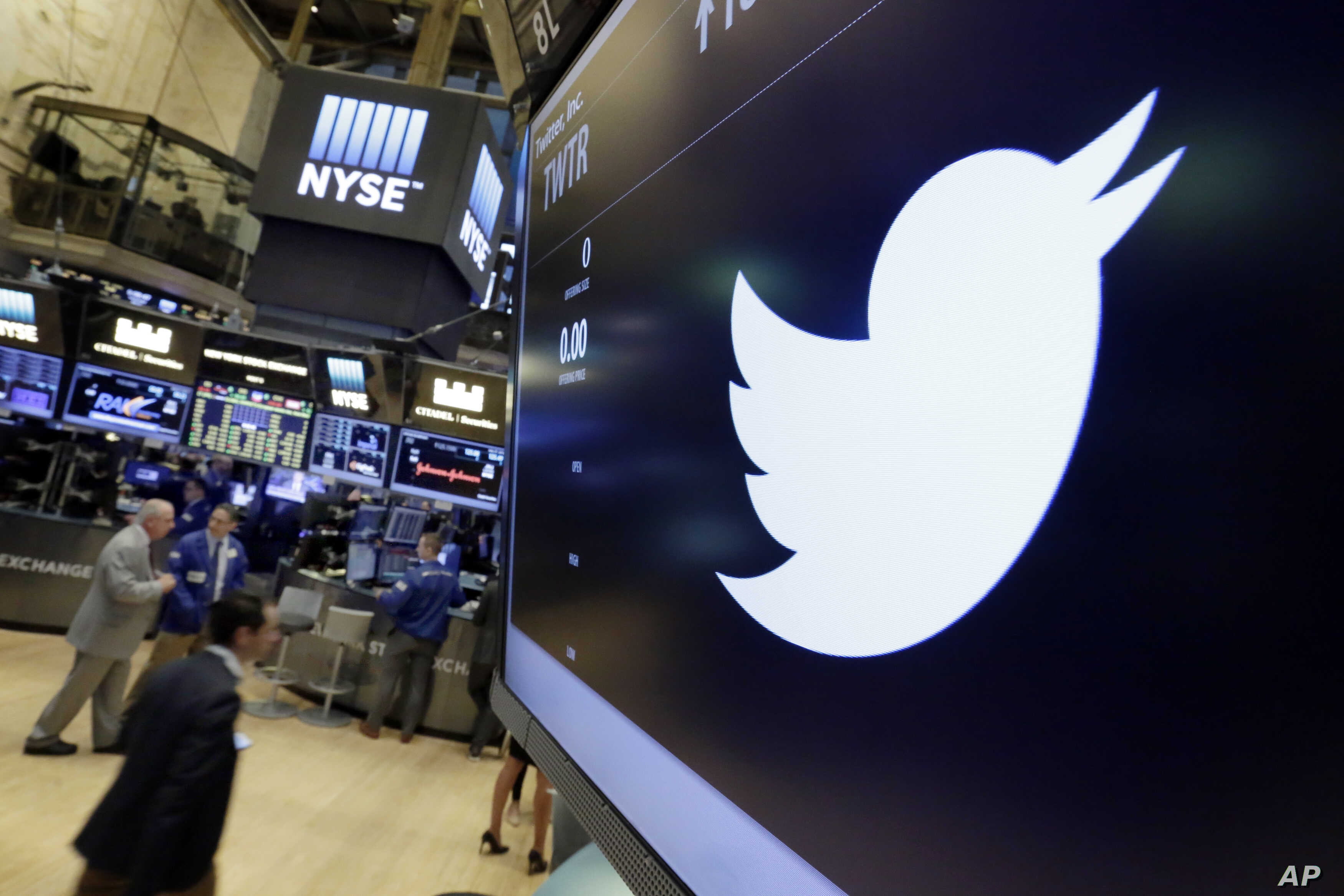 FILE - The Twitter symbol appears above a trading post on the floor of the New York Stock Exchange, July 27, 2016.  Twitter, long criticized as a hotbed for online harassment, is expanding ways to curb the amount of abuse users see and making it easi