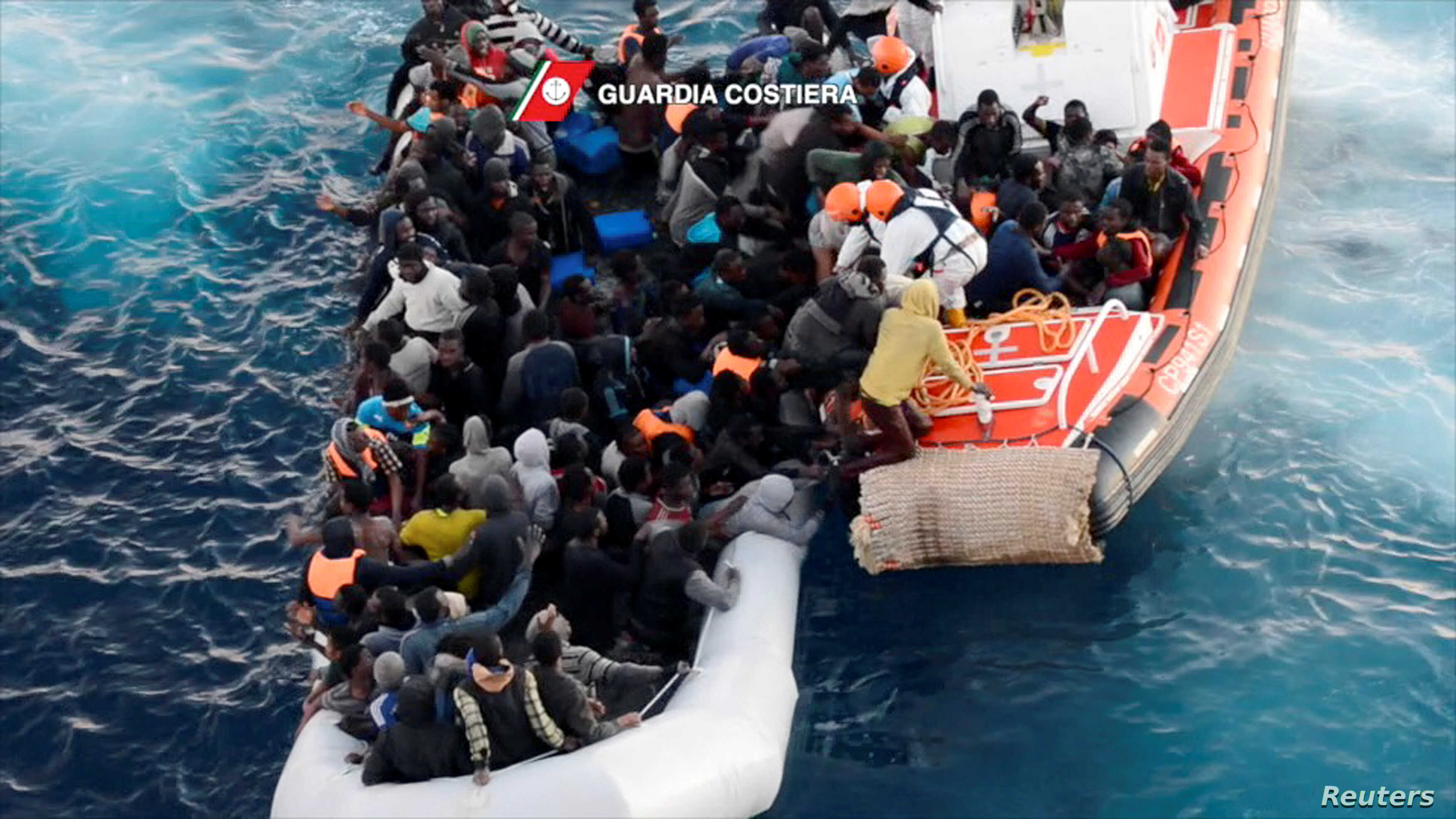 FILE - An image taken from video shot on Jan. 27, 2017 by the Italian Coast Guard shows migrants being rescued from members of Italian Coast Guard vessel Diciotti in the central Mediterranean sea.