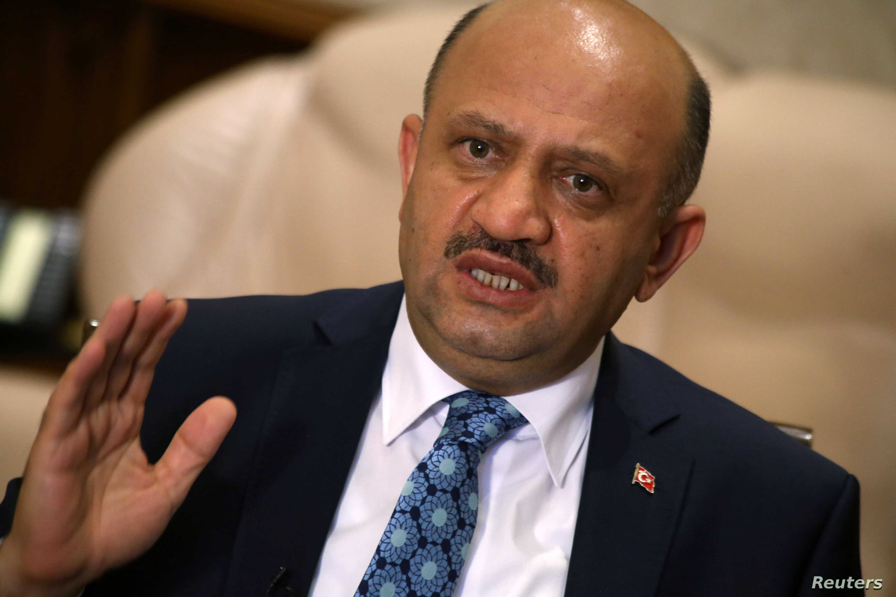 Turkey's Defence Minister Fikri Isik answers a question during an interview in Ankara, Aug. 5, 2016.