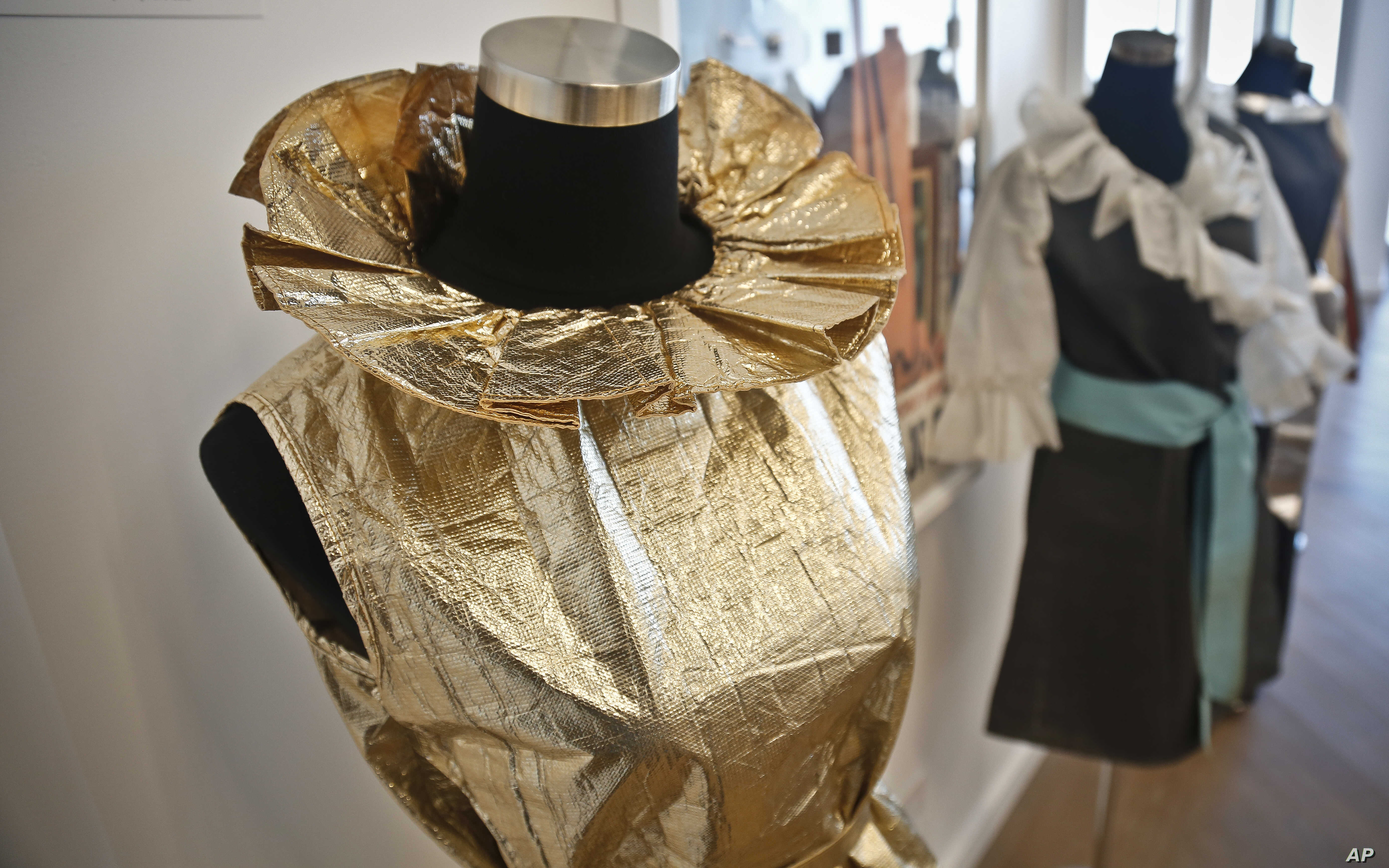 In this Oct. 4, 2017 photo, a TWA disposable paper uniform worn by flight attendants, is displayed at an installation of retro items at the company's meeting space in One World Trade Center in New York.
