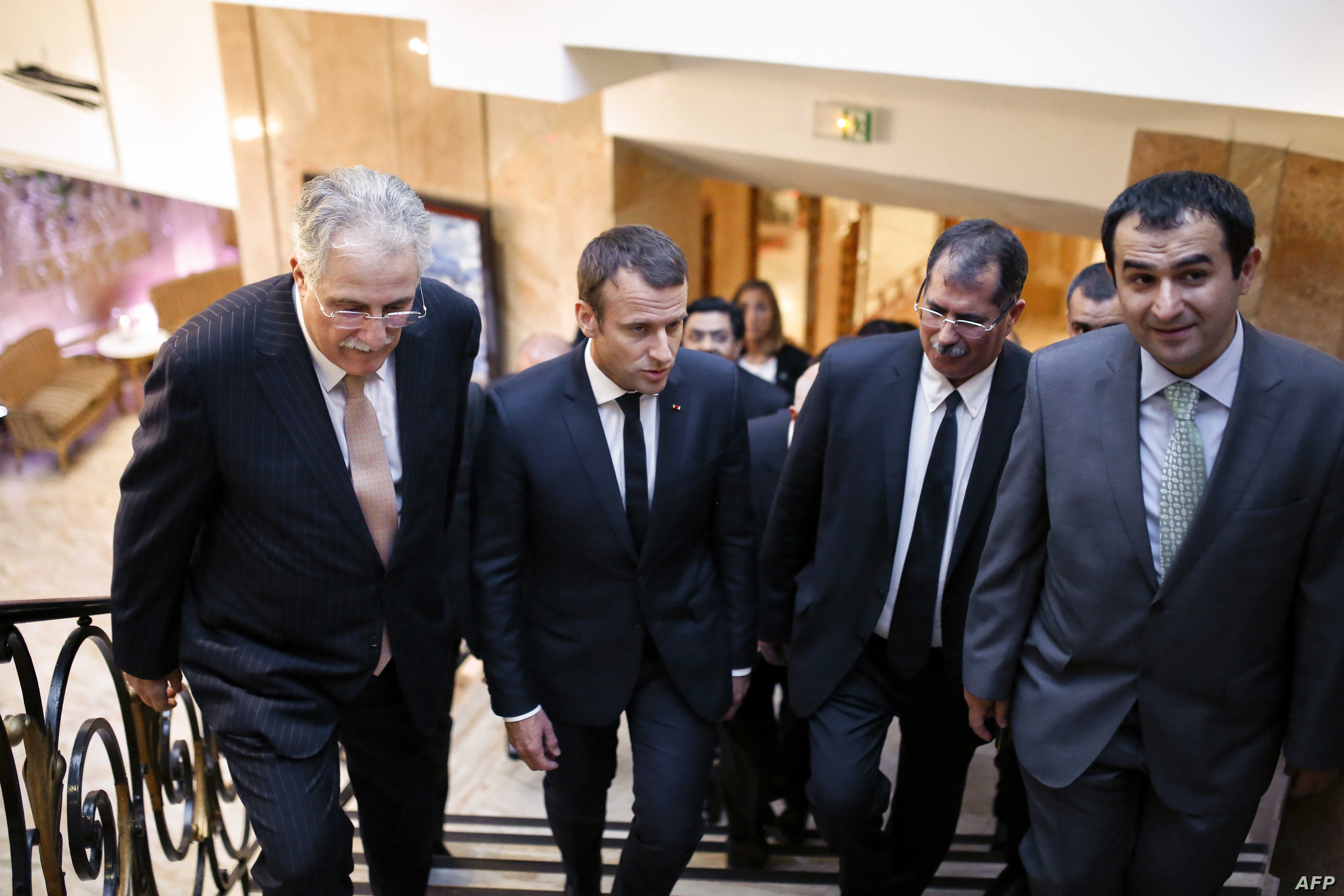 (LtoR) Vice President of the French Council of the Muslim Faith (CFCM) Chems-Eddine Hafiz, French President Macron, CFCM President Anouar Kbibech and CFM Vice President Ahmet Ogras, arrive to attend a dinner organized by CFCM, June 20, 2017.