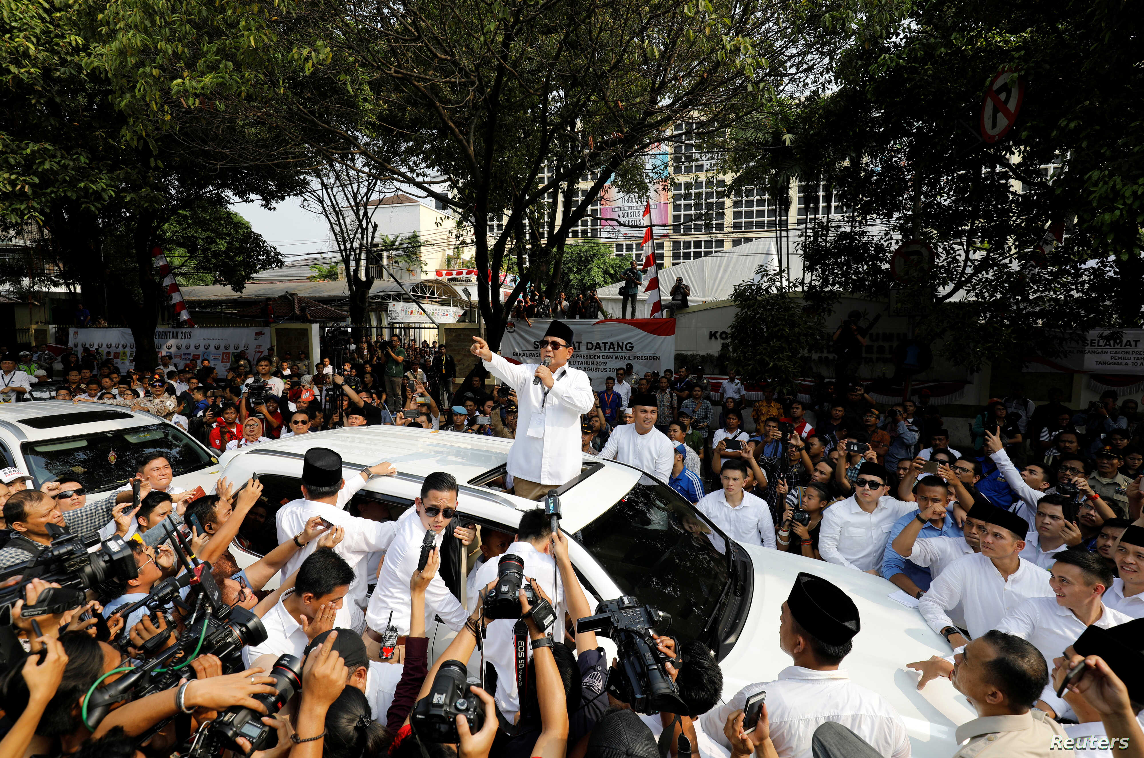 FILE - Former general and head of the Gerinrda Party Prabowo Subianto speaks to supporters after registering himself and his running mate, former Jakarta Deputy Governor Sandiaga Uno, as candidates for the 2019 presidential election outside the Gener...