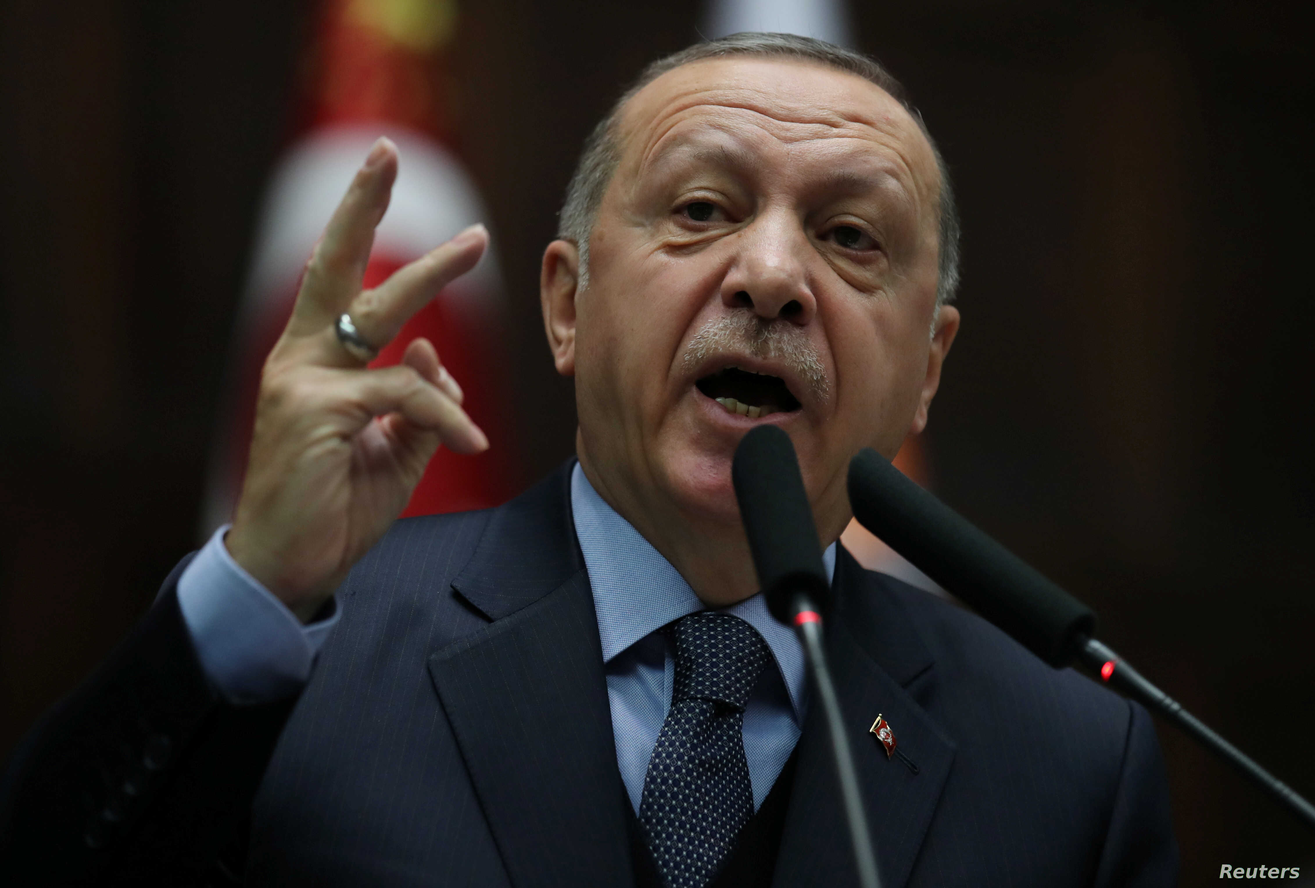 Turkish President Tayyip Erdogan addresses members of parliament from his ruling AK Party (AKP) during a meeting at the Turkish parliament in Ankara, Turkey, Jan. 8, 2019.