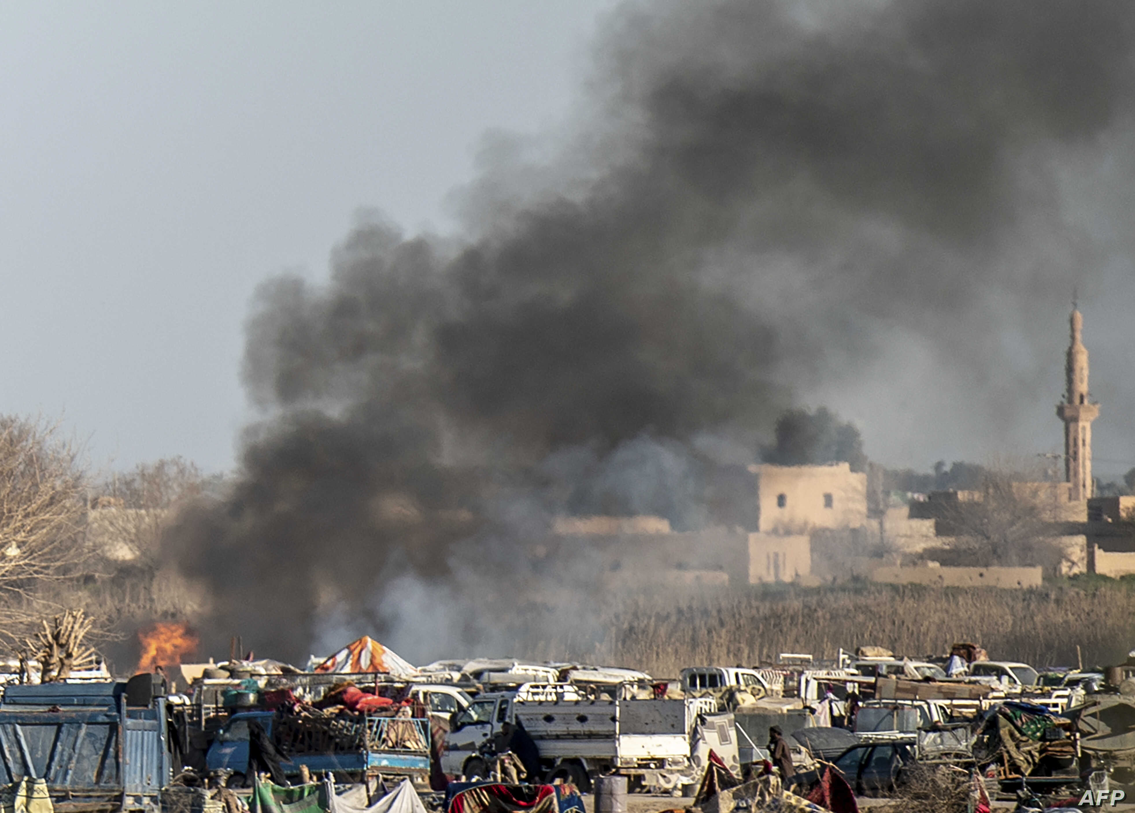 Smoke rises from a makeshift camp for Islamic State members and their families in the town of Baghuz, in the eastern Syrian province of Deir el-Zour, March 9, 2019.