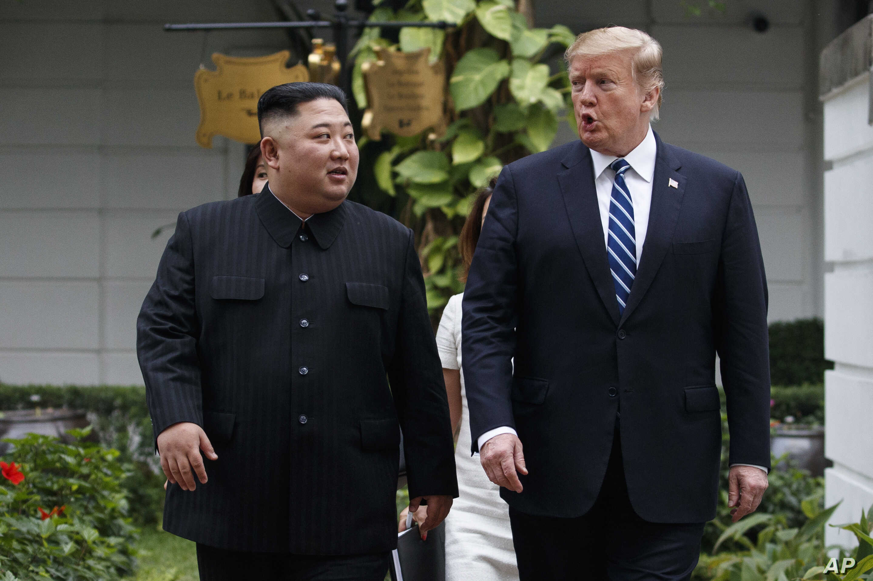 U.S. President Donald Trump and North Korean leader Kim Jong Un take a walk after their first meeting at the Sofitel Legend Metropole Hanoi hotel, Feb. 28, 2019, in Hanoi.