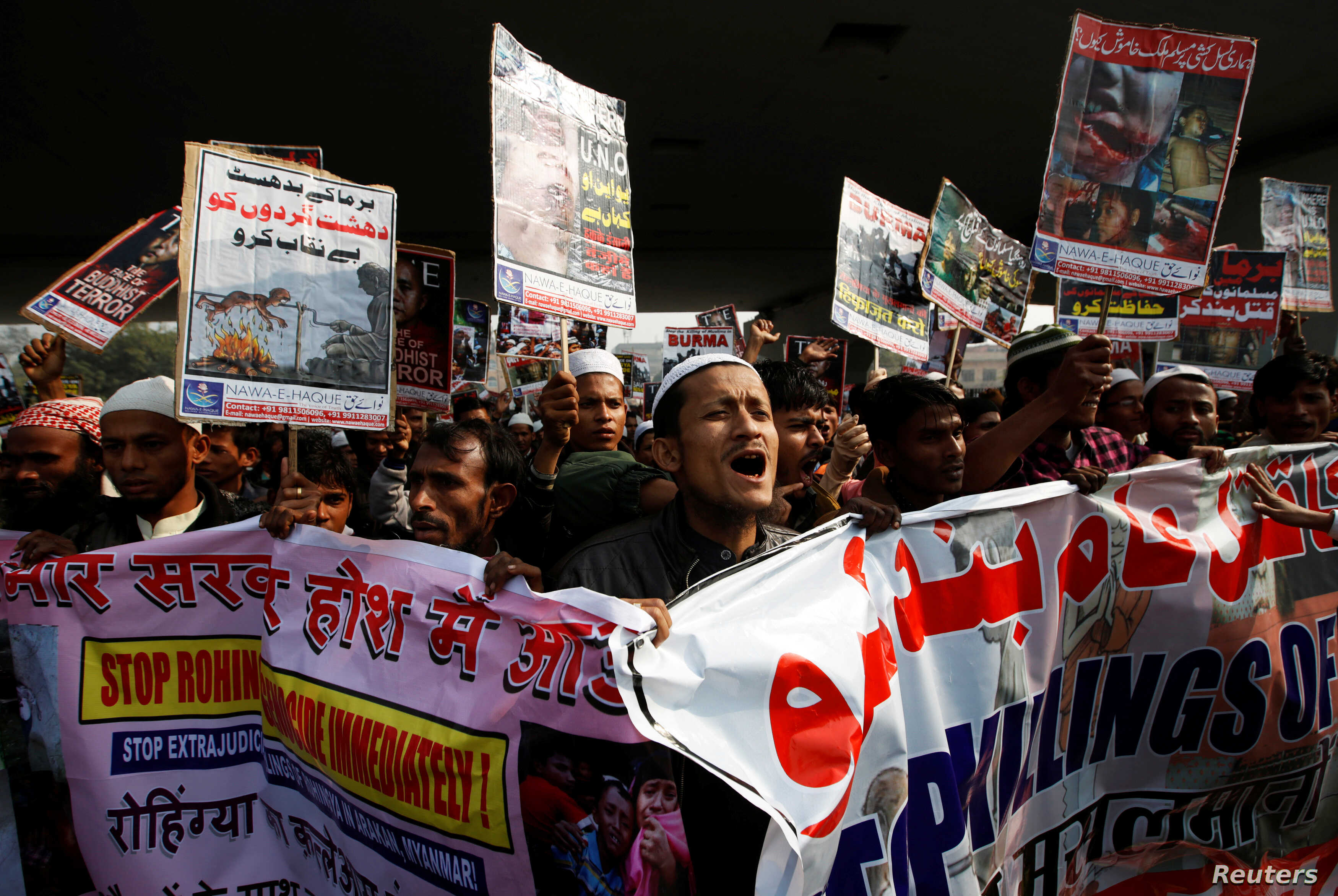 Rohingya Muslim refugees shout slogans during a protest against what organizers say is the crackdown on ethnic Rohingyas in Myanmar, in New Delhi, India, Dec. 19, 2016.