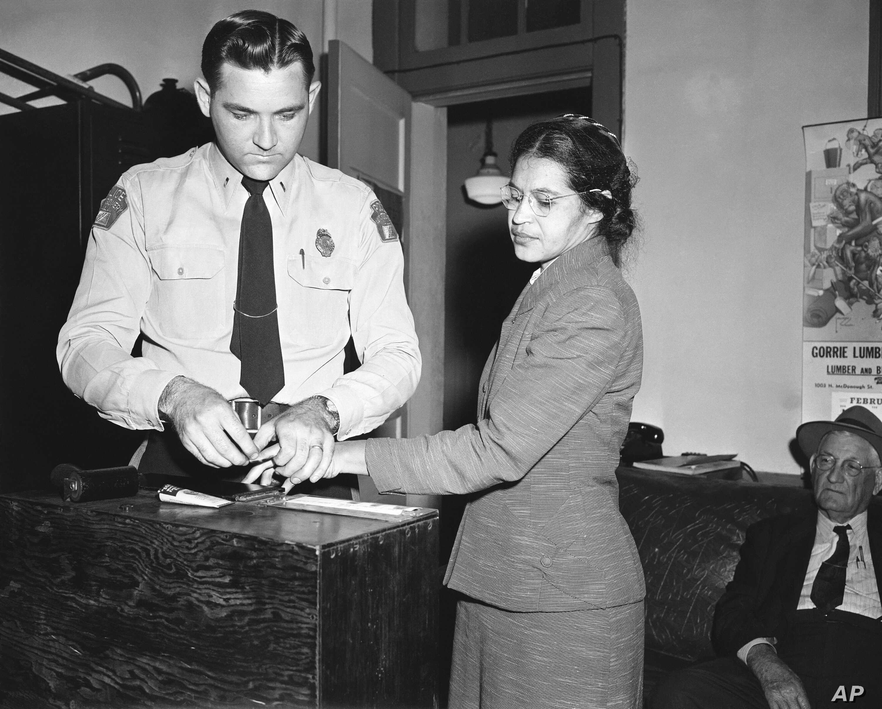 FILE - Rosa Parks, whose refusal to move to the back of a bus, touched off the Montgomery bus boycott and the beginning of the civil rights movement, is fingerprinted by police Lt. D.H. Lackey in Montgomery, Alabama, Feb. 22, 1956.