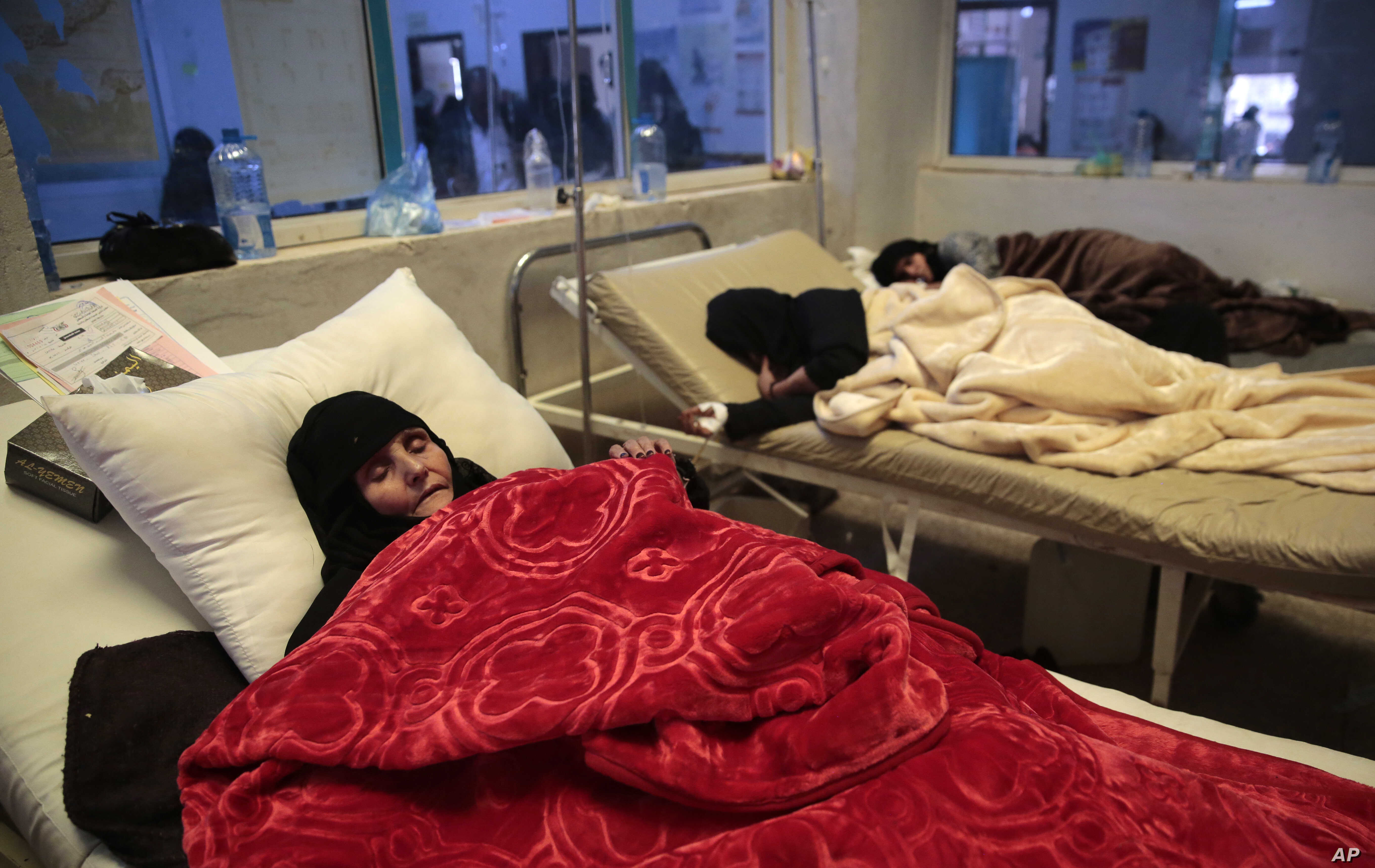 Women are treated for a suspected cholera infection at a hospital in Sanaa, Yemen, May 15, 2017.