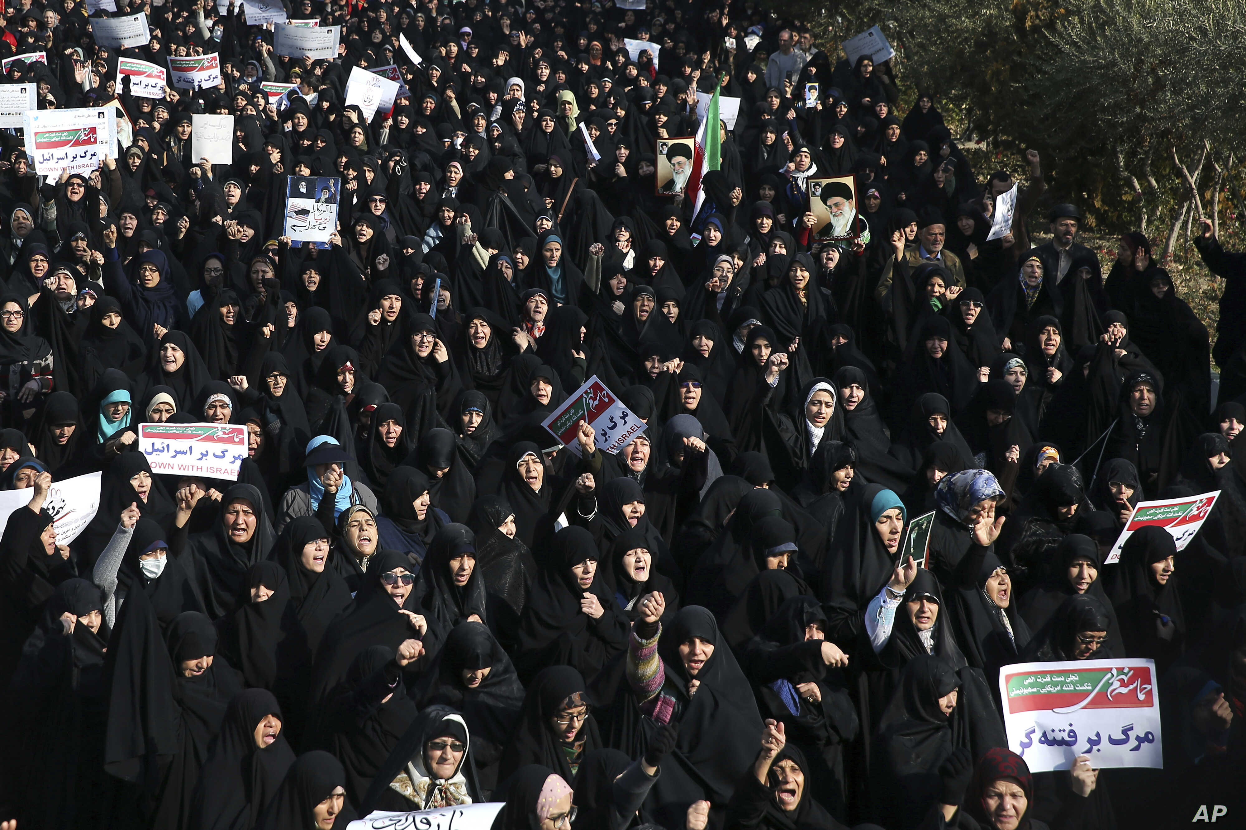 Iranian protesters chant slogans at a rally in Tehran, Iran, Dec. 30, 2017. Iranian hard-liners rallied Saturday to support the country's supreme leader and clerically overseen government as spontaneous protests sparked by anger over the country's ai...