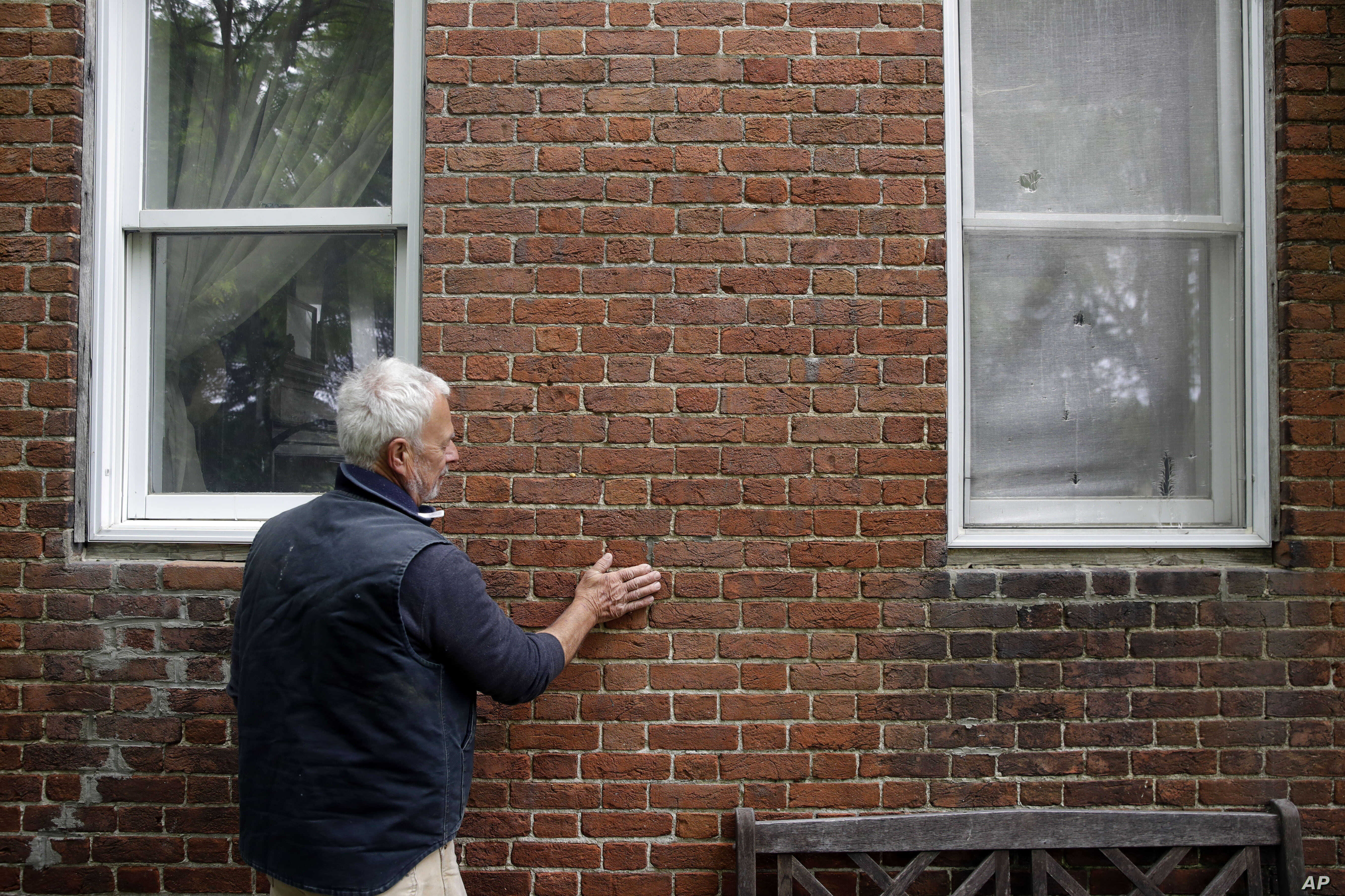 Michael McCrea shows where people have come to touch his house, the former home of Jacob and Hannah Leverton, once a key stopping point for slaves seeking sanctuary on the Underground Railroad in Preston, Maryland, May 12, 2017.