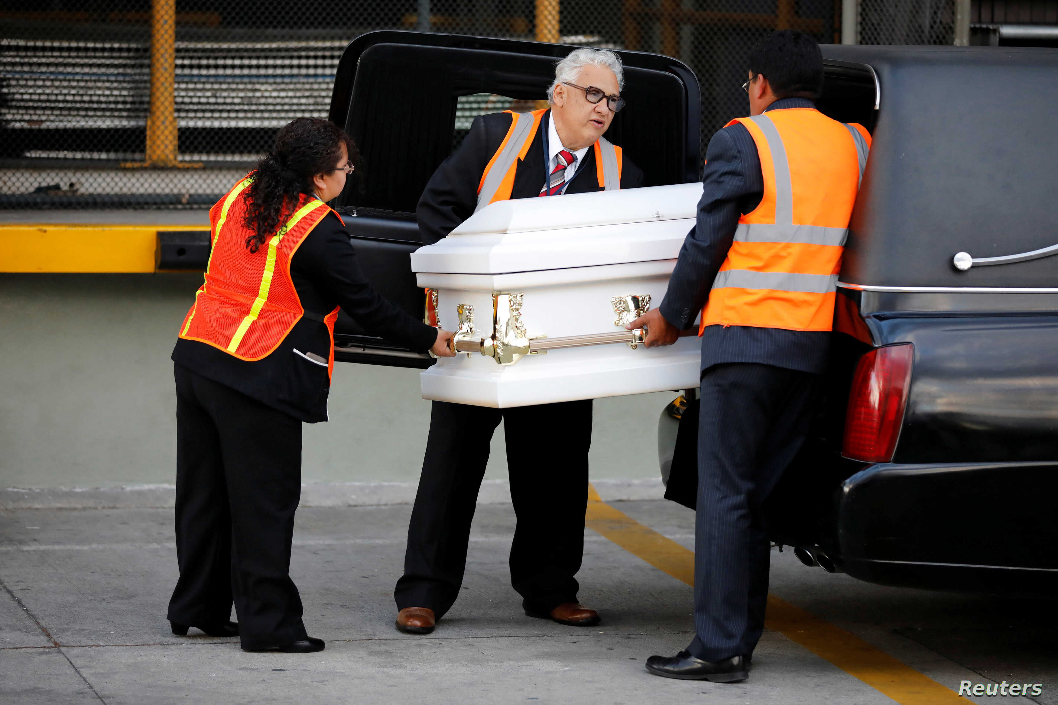 Staff of a funeral home receive the coffin containing the body of Jakelin Caal before her funeral, at La Aurora International Airport in Guatemala City, Guatemala, Dec. 23, 2018.