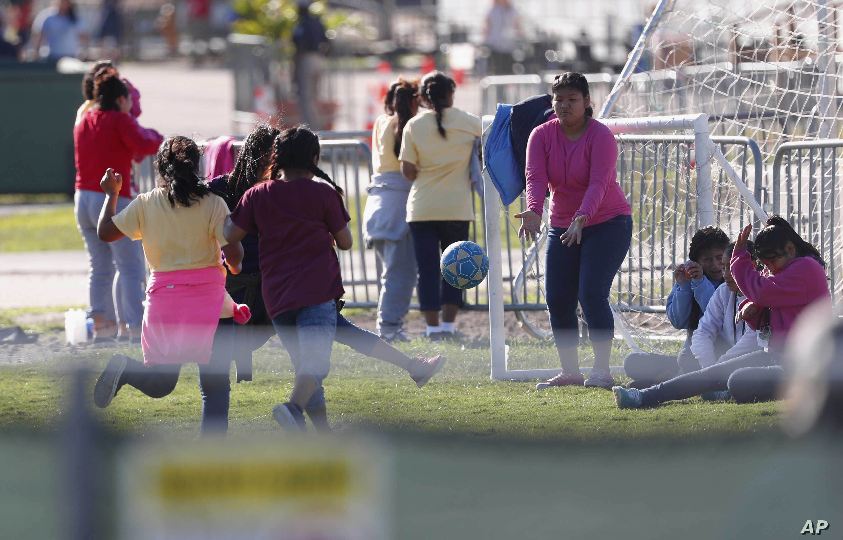 Girls play soccer at the Homestead Temporary Shelter for Unaccompanied Children in Homestead, Fla., Feb. 19, 2019.