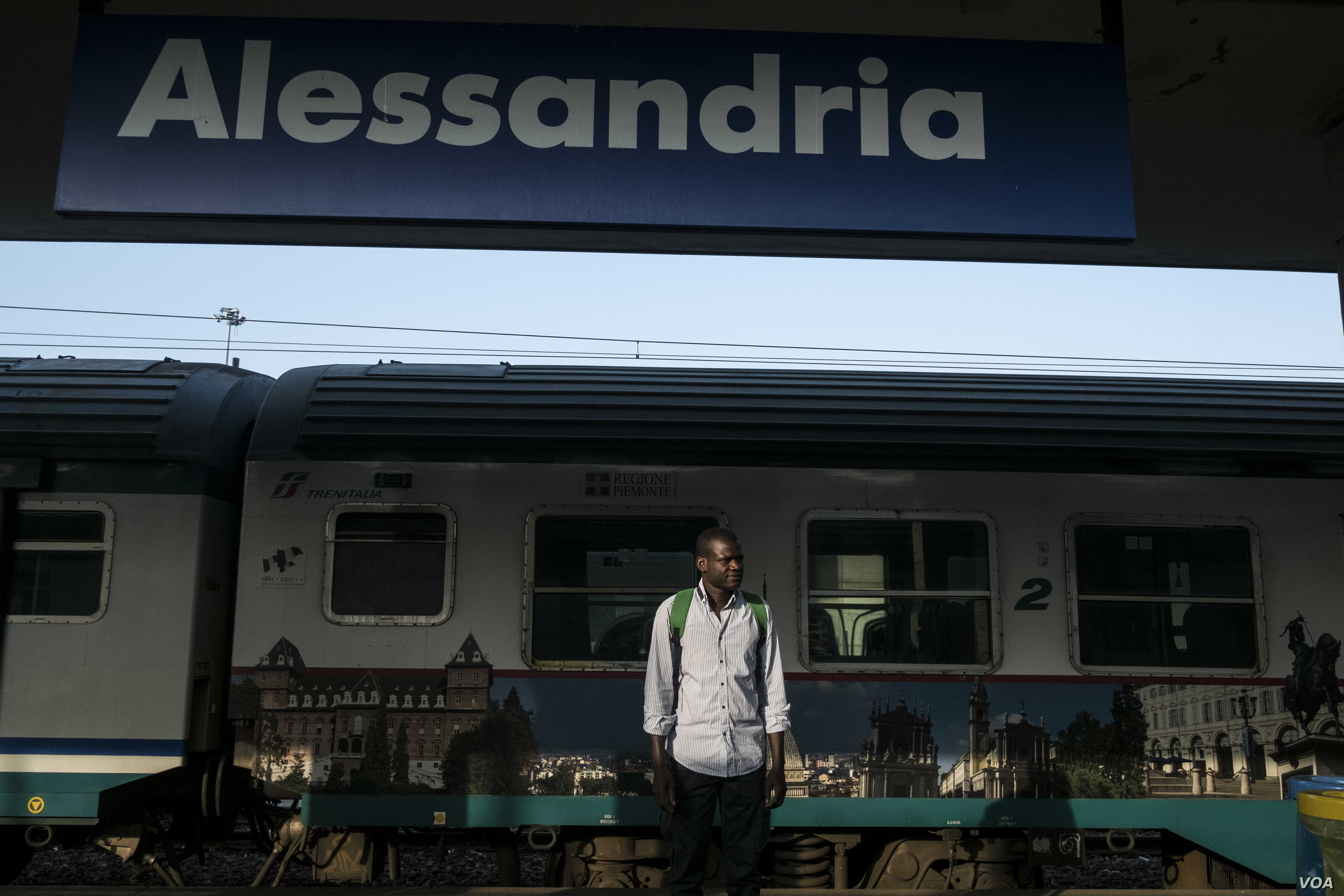 """Every morning, Abdul Adan takes a 20-minute train ride to Alessandria, Italy, where he works with bee hives and in an organic garden to sell produce, Aug. 22, 2017. """"I feel very lonely, very very,"""" he says."""