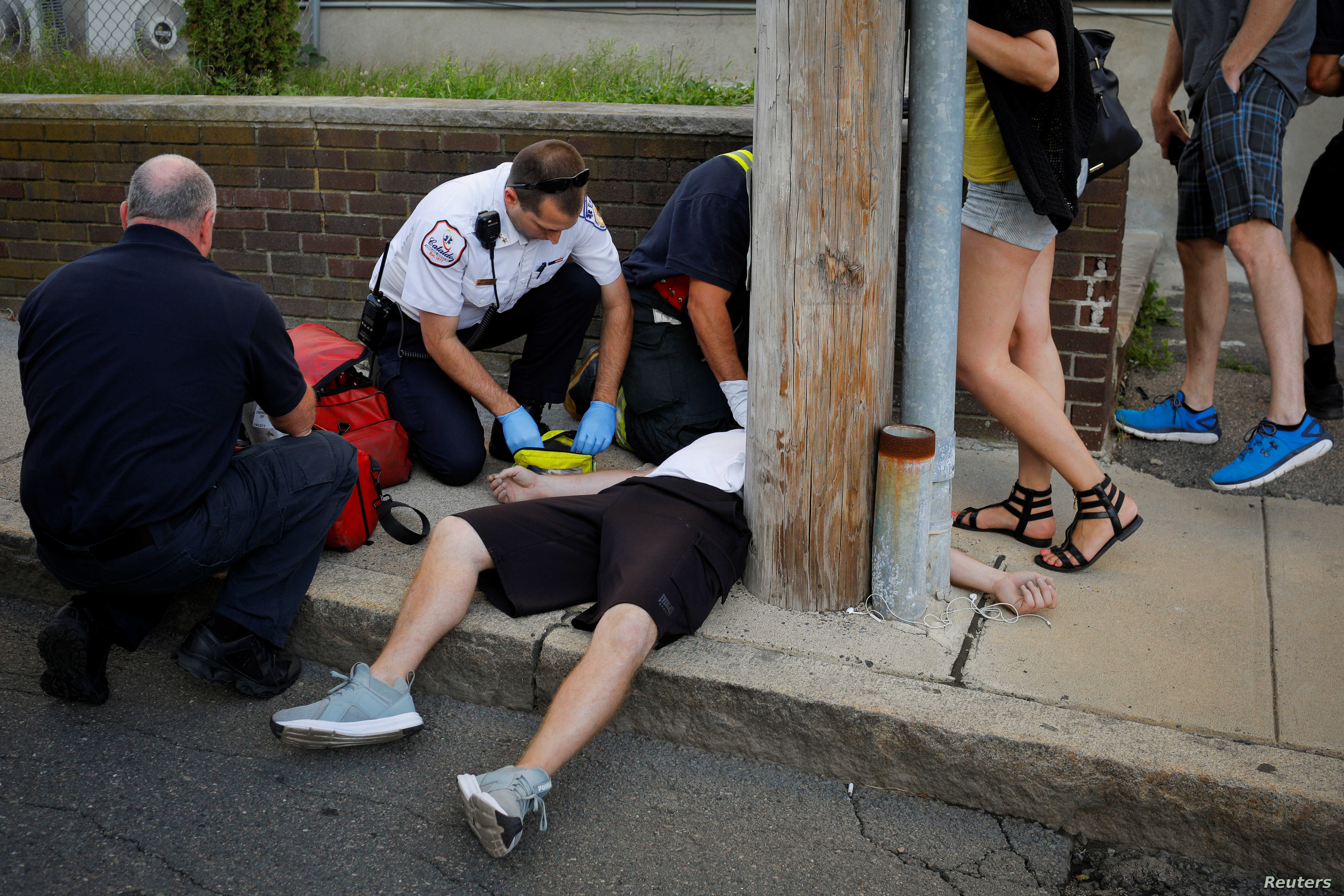 Cataldo Ambulance medics and other first responders revive a 32-year-old man who was found unresponsive and not breathing after an opioid overdose on a sidewalk in the Boston suburb of Everett, Massachusetts, Aug. 23, 2017.