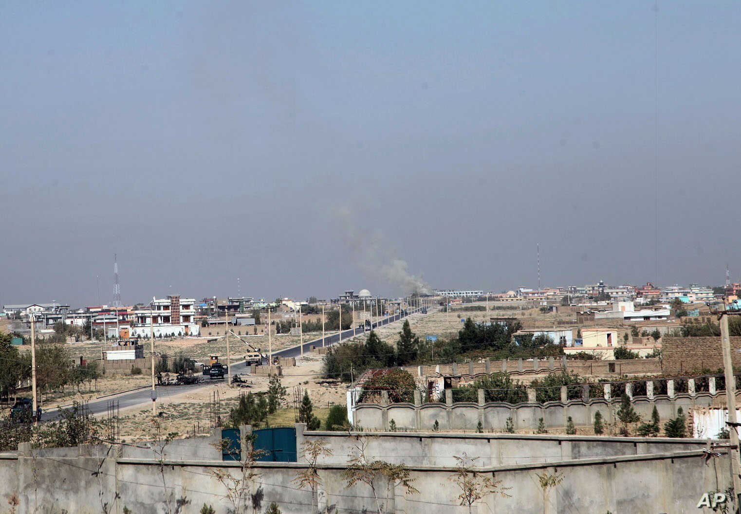 Smoke rises from  an unknown point in Kunduz city, north of Kabul, Afghanistan. Oct. 1, 2015.