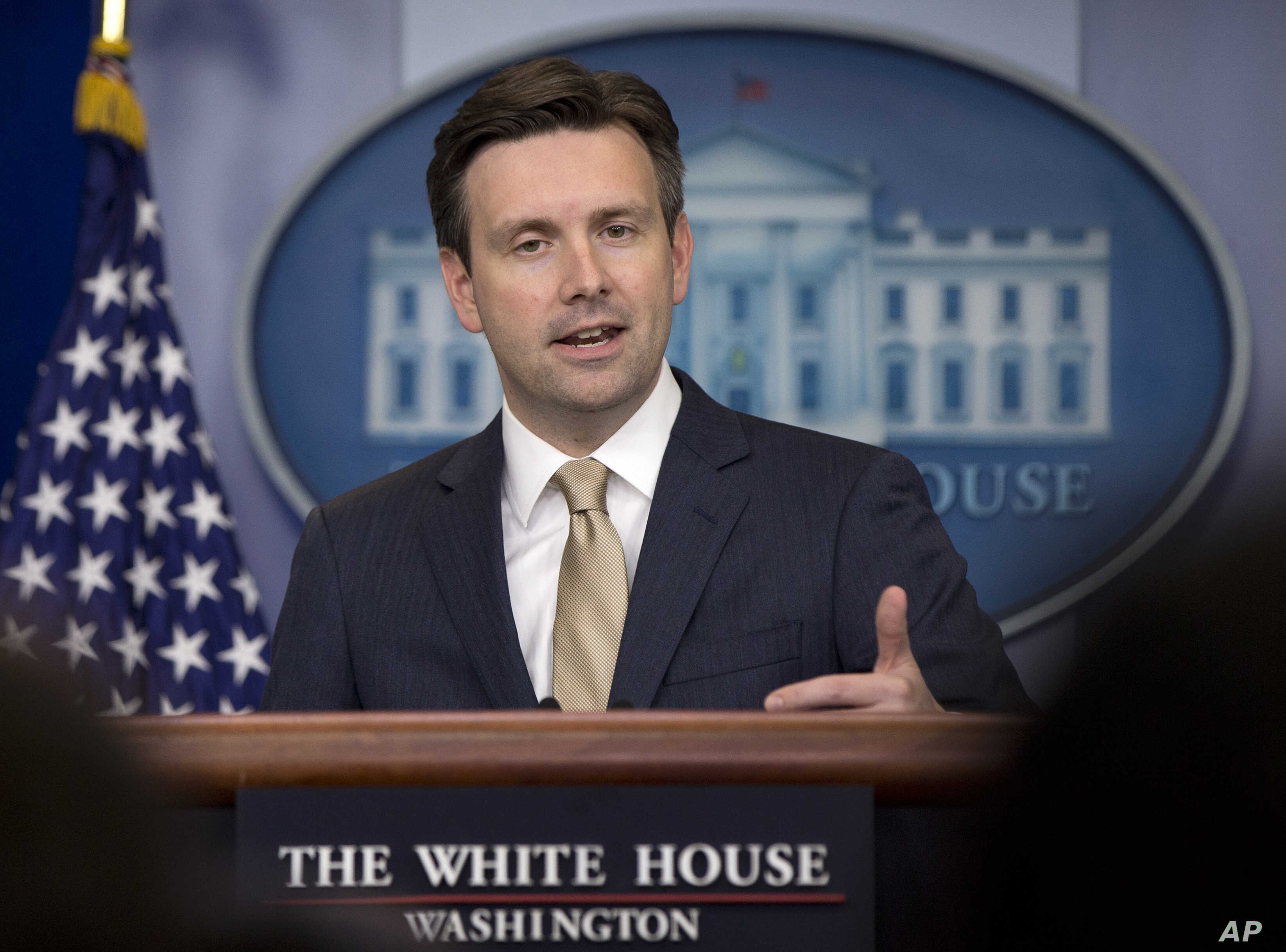 FILE - White House press secretary Josh Earnest speaks during the daily news briefing at the White House in Washington.