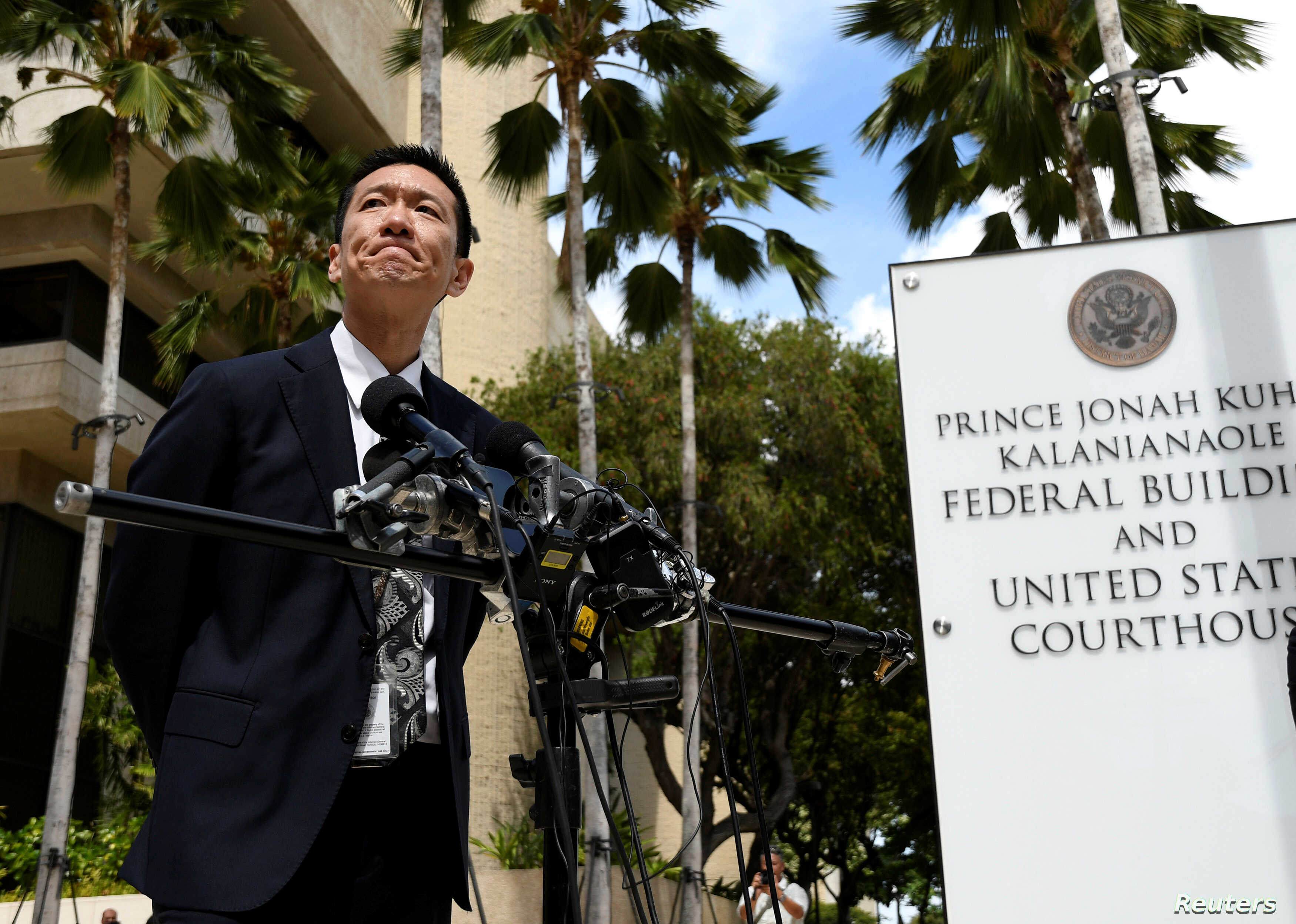 Hawaii Attorney General Douglas Chin answers questions from the media at the U.S. District Court Ninth Circuit after presenting his arguments after filing an amended lawsuit against President Donald Trump's new travel ban in Honolulu, Hawaii, March 1...