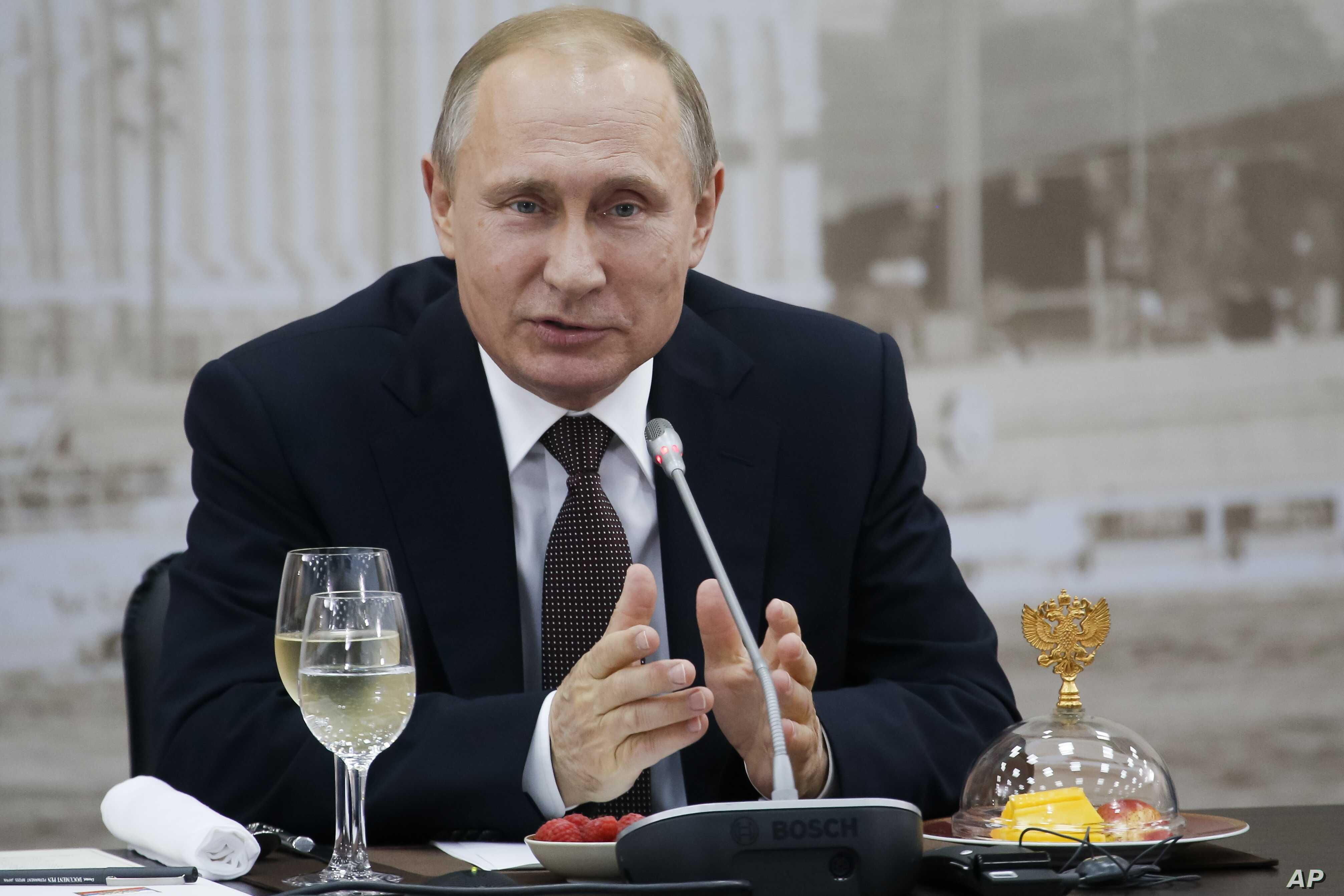Russian President Vladimir Putin speaks at a meeting with chief executives of international companies at the St. Petersburg International Economic Forum in St. Petersburg, June 17, 2016.