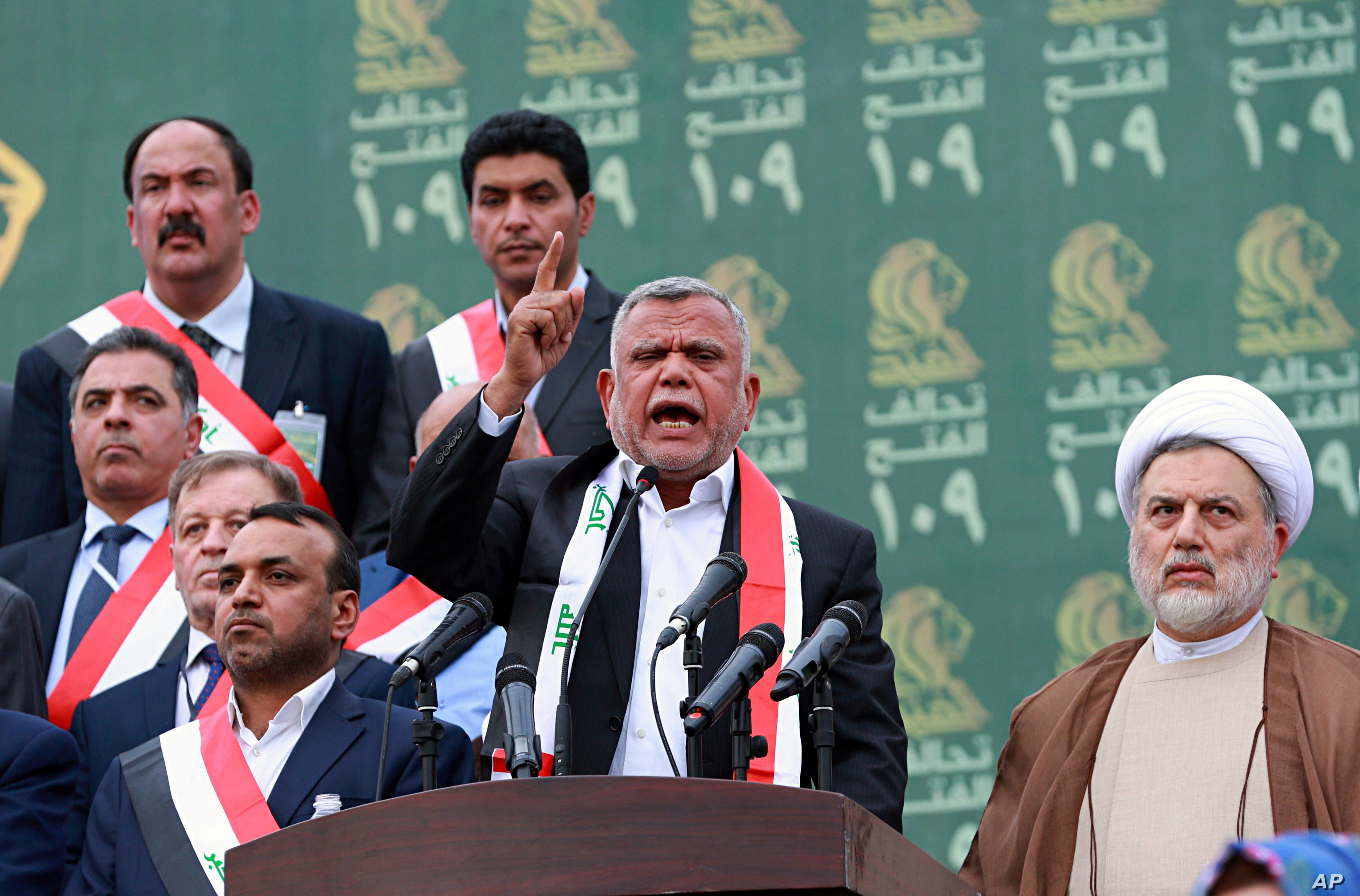 FILE - Hadi al-Amiri, center, speaks to his followers during his political block campaign rally in Baghdad, Iraq, May 7, 2018.