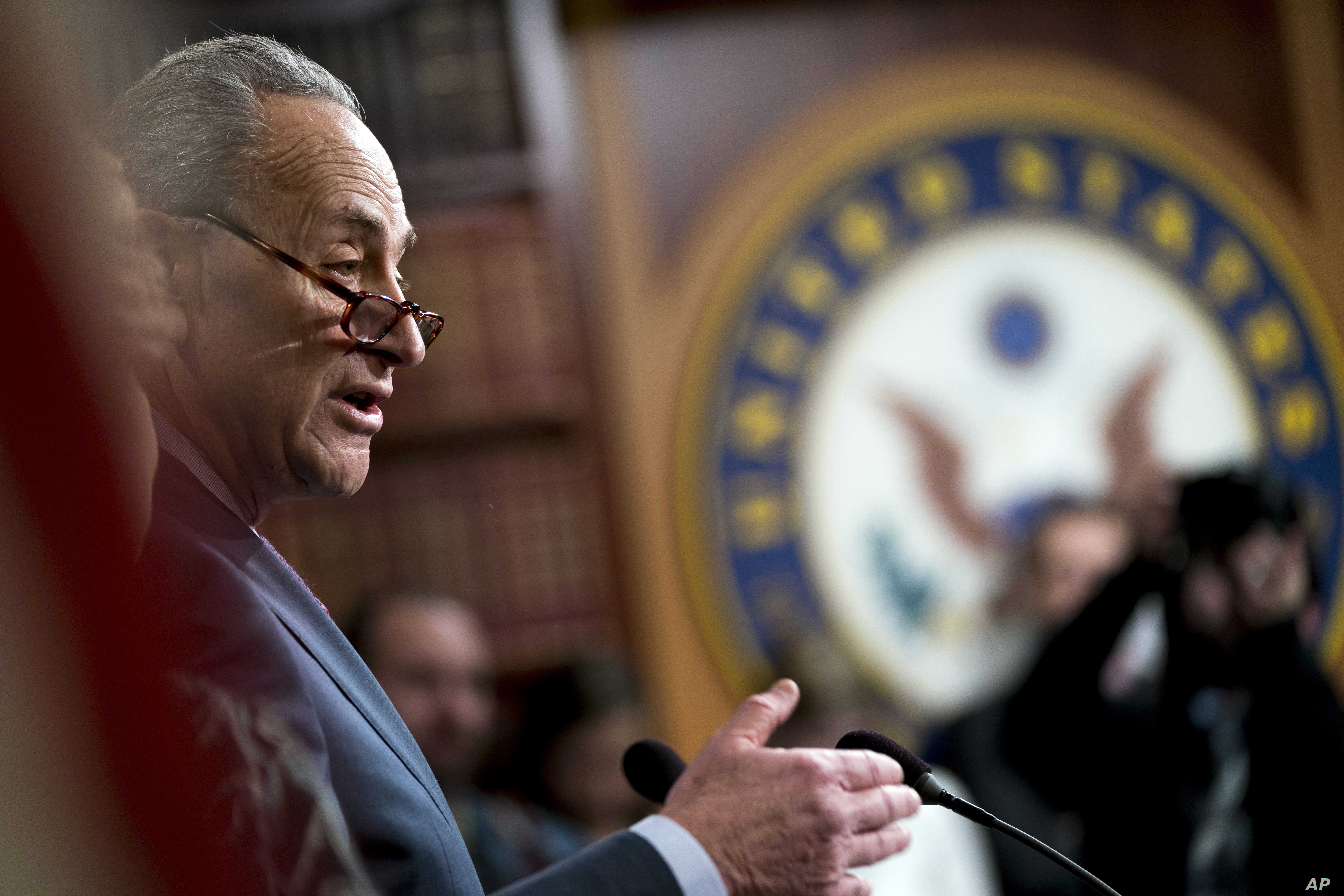 Senate Minority Leader Sen. Chuck Schumer of N.Y. speaks at a news conference on Capitol Hill in Washington, Dec. 21, 2017.