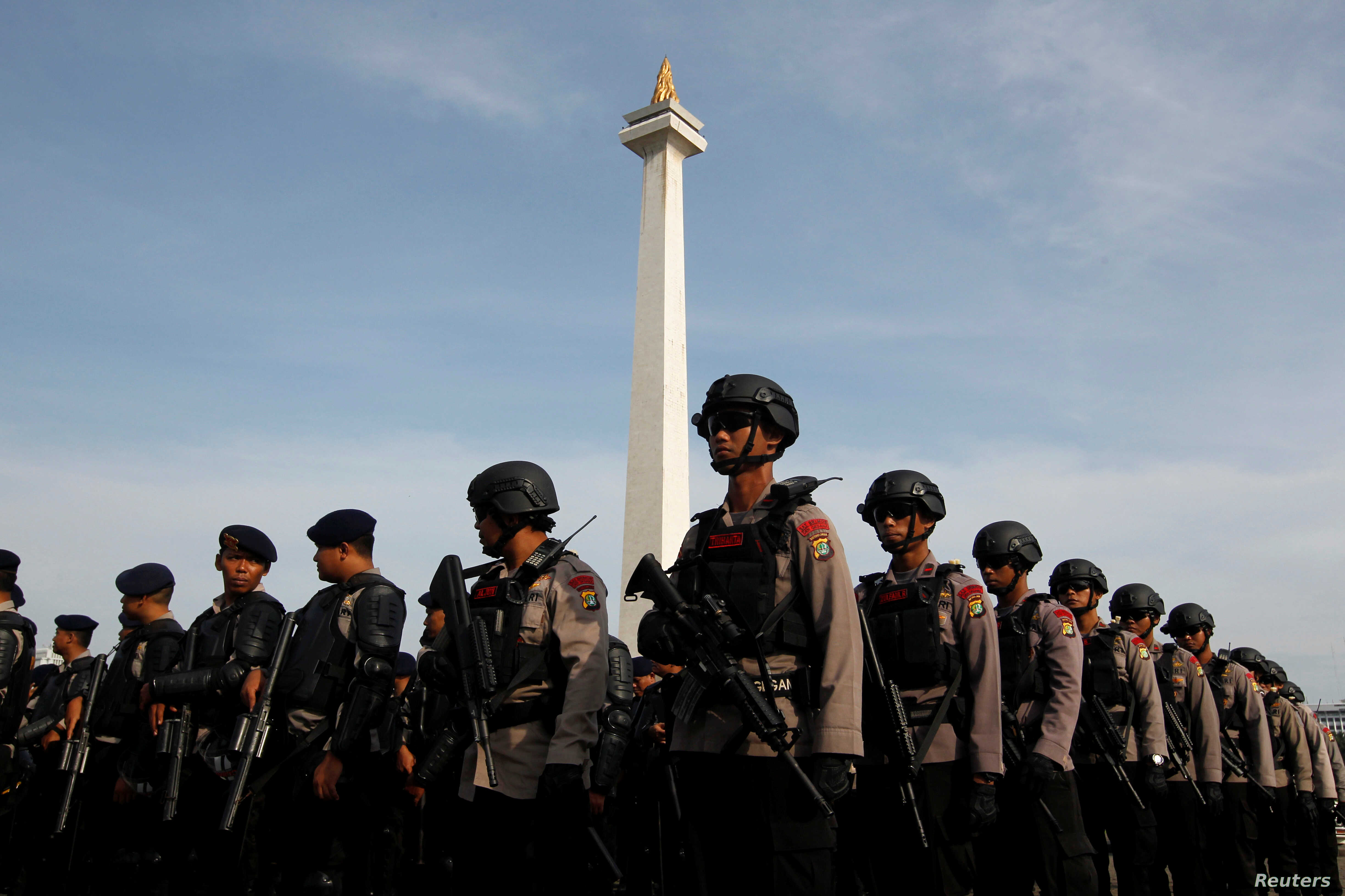 Anti-riot police stand during security preparations ahead of Friday's planned protest by hard-line Muslim groups in Jakarta, Indonesia, Nov. 2, 2016.