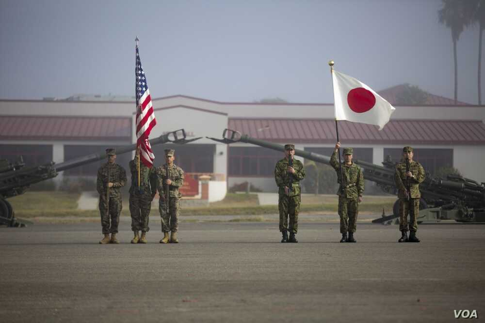 Marines with 1st Battalion, 4th Marines, 1st Marine Division and Western Army Infantry Regiment, Japan Ground Self Defense Force stand in formation as part of the Exercise Iron Fist 2018 opening ceremony at Camp Pendleton, Calif., Jan. 12, 2018. (U.S...