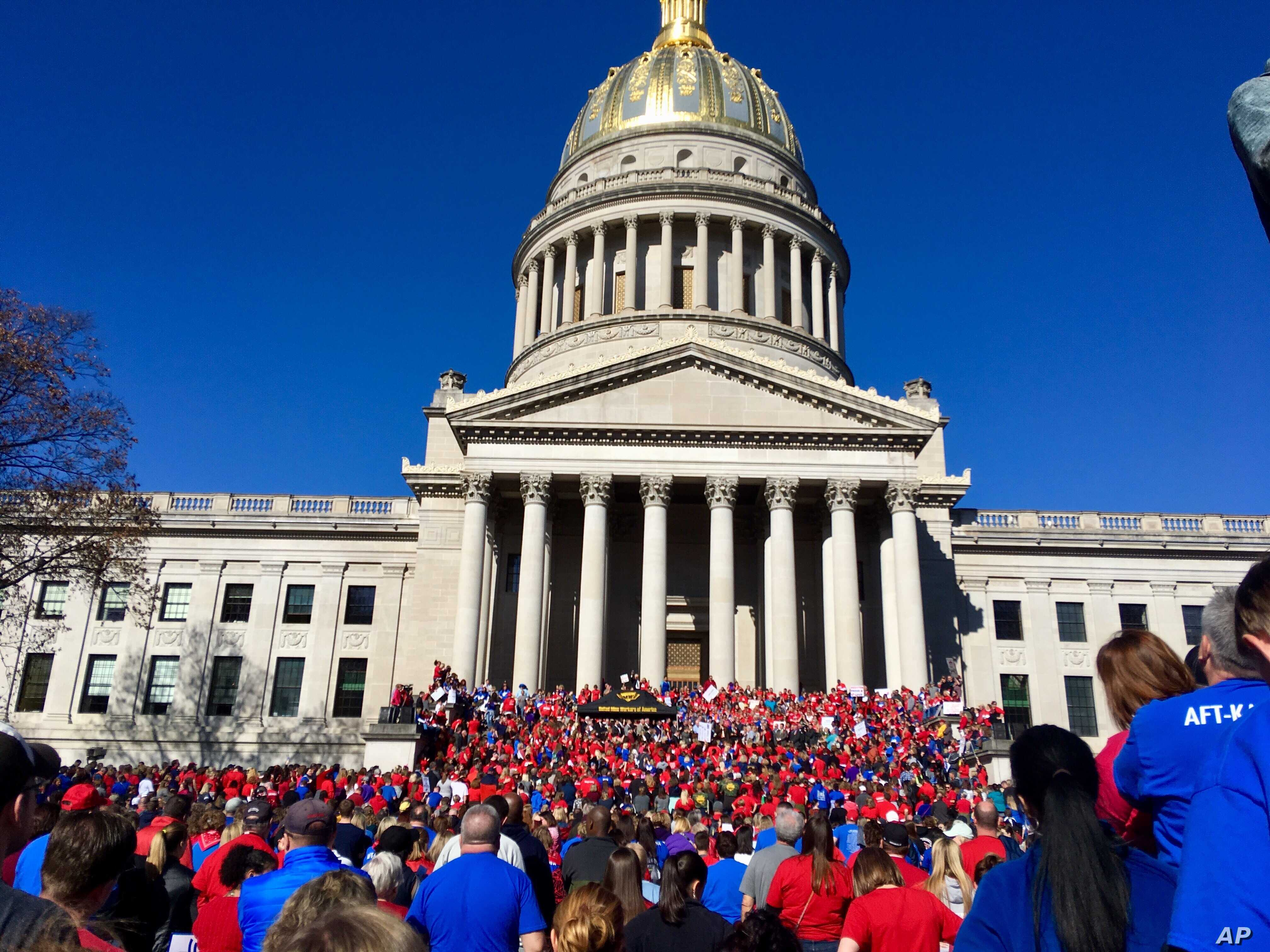 Thousands of West Virginia teachers attend a rally at the state Capitol in Charleston, W.Va., Feb. 26, 2018.