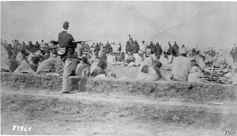 Navajos under guard at Fort Sumner, Bosque Redondo, ca. 1864.  Courtesy: National Archives, Washington, DC