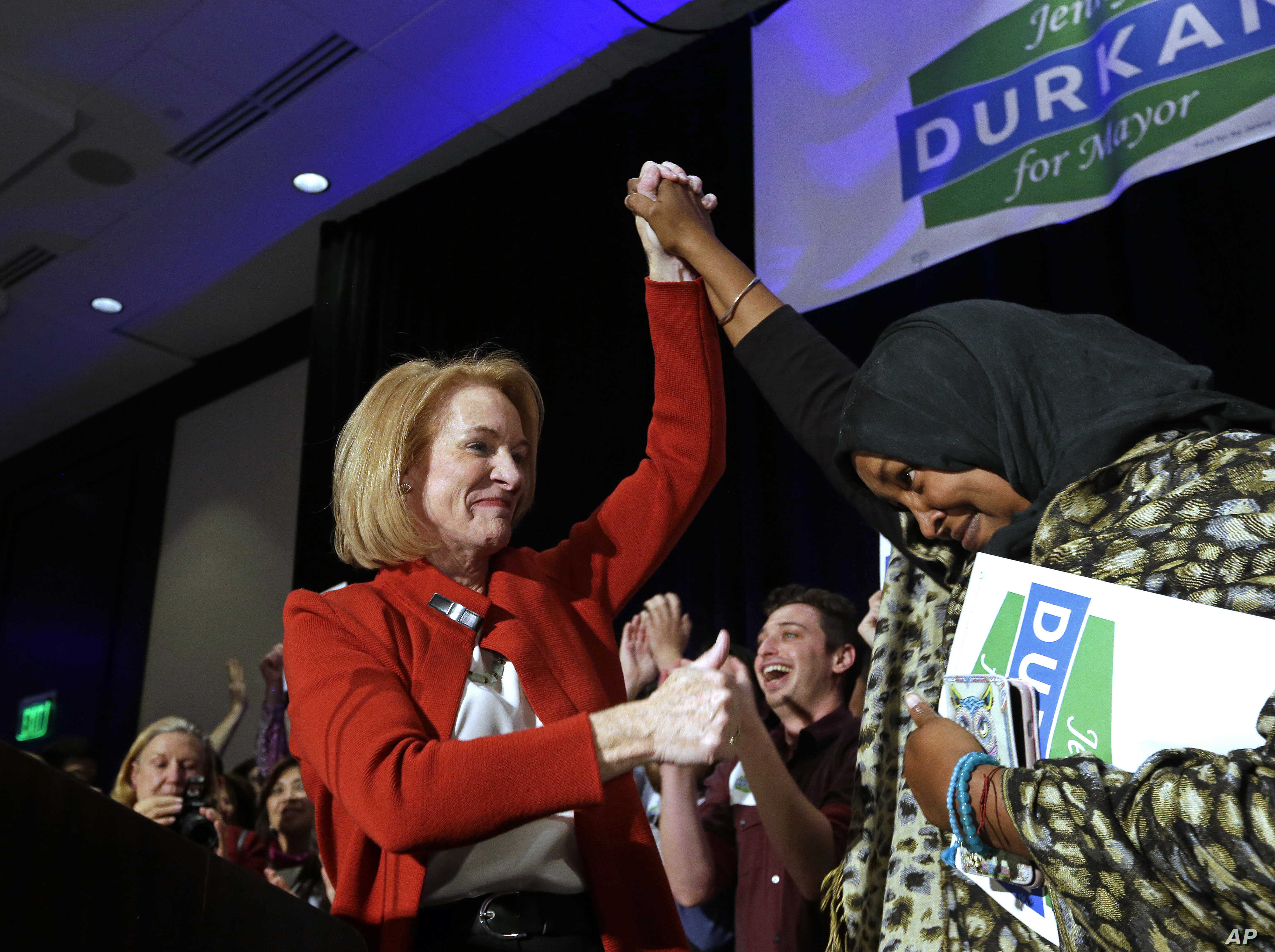 Jenny Durkan gives a thumbs-up to a supporter while taking the stage at an election night party in Seattle, Nov. 7, 2017. Durkan was elected as the city's first lesbian mayor.