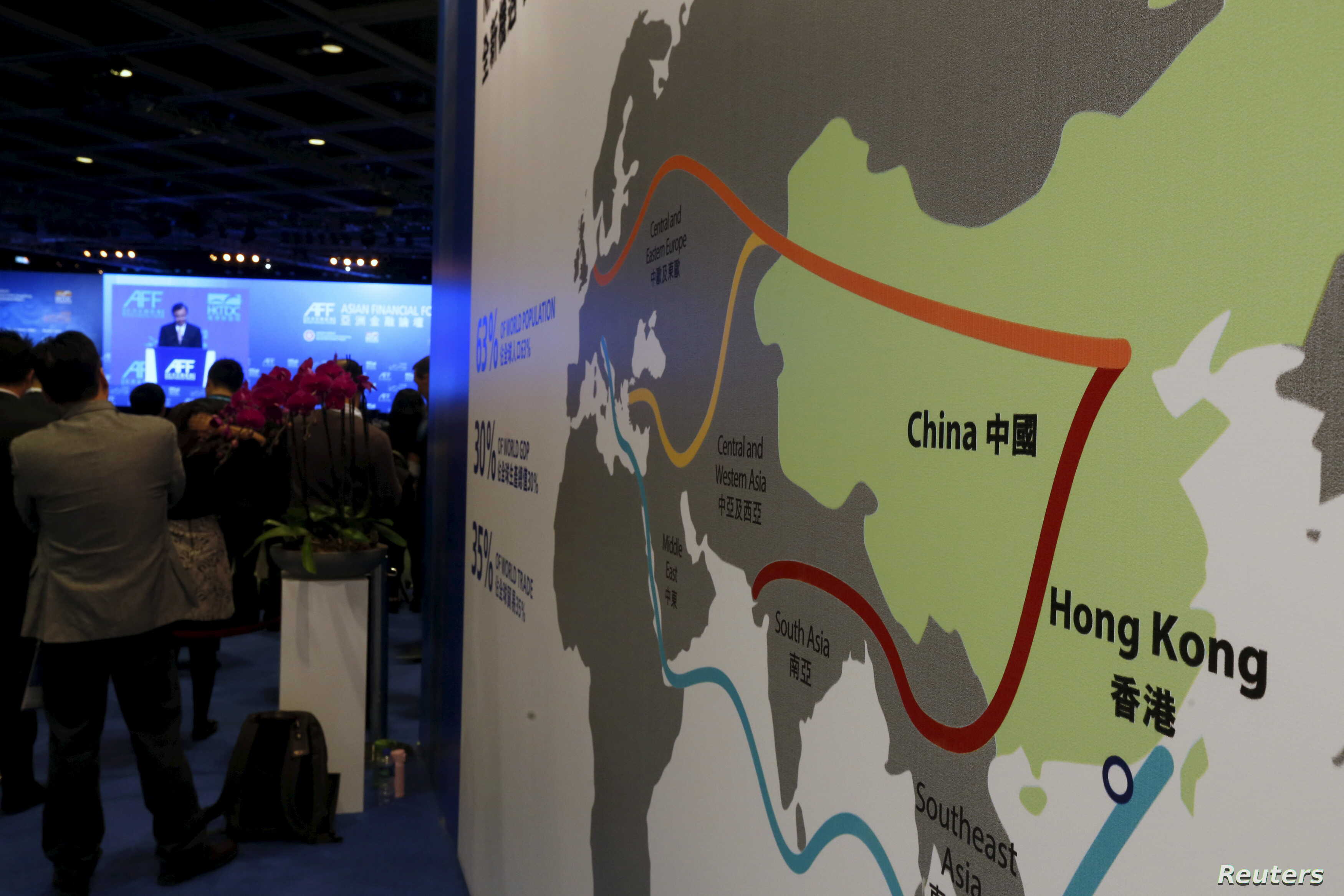 """FILE - A map illustrating China's silk road economic belt and the 21st century maritime silk road, or the so-called """"One Belt, One Road"""" megaproject, is displayed at the Asian Financial Forum in Hong Kong, China Jan. 18, 2016."""